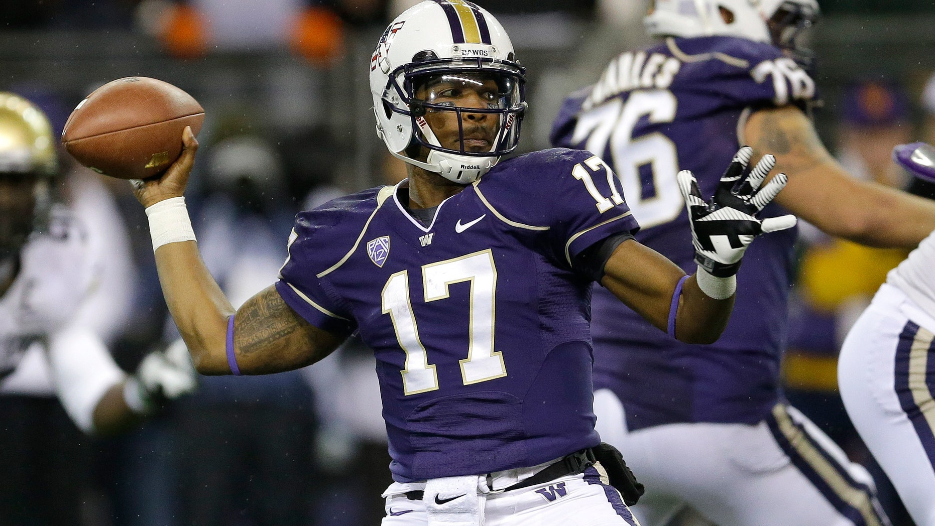 Washington quarterback Keith Price (17) passes against Colorado in the first half of an NCAA college football game on Saturday, Nov. 9, 2013, in Seattle. (AP Photo/Ted S. Warren)