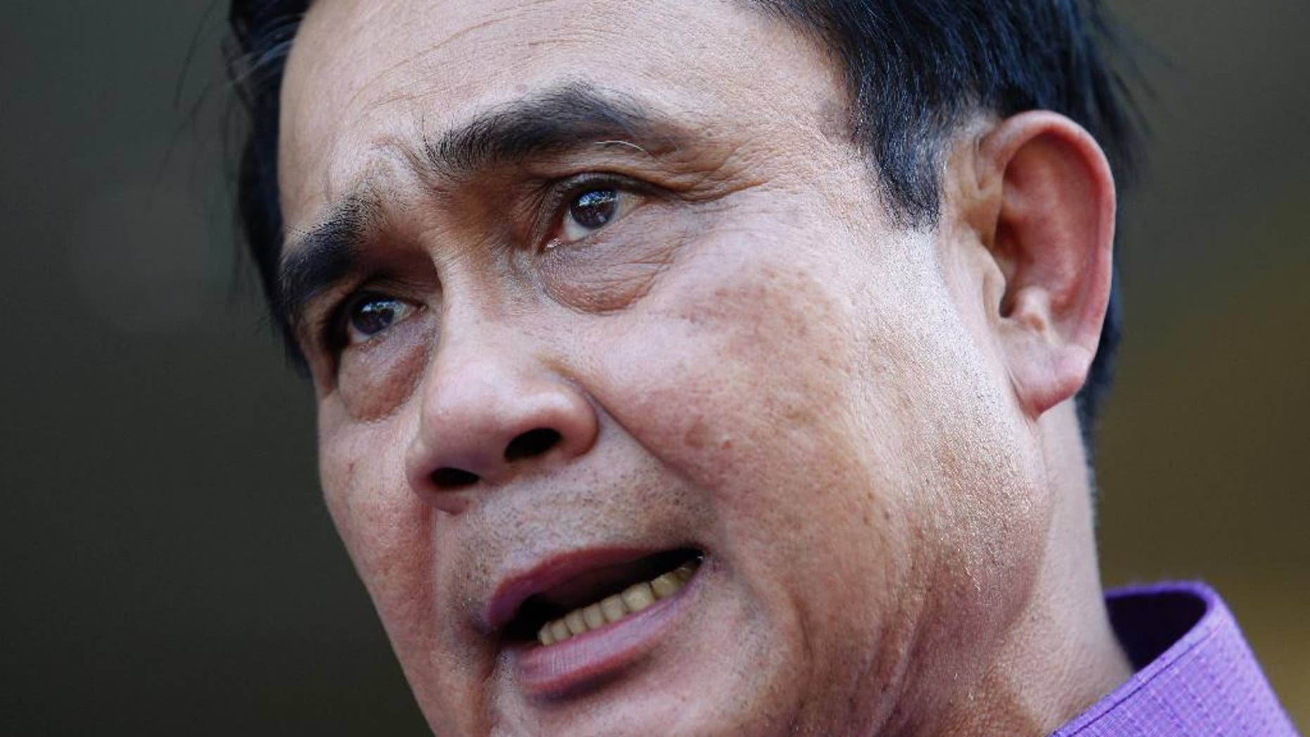 March 31, 2015: In this file photo, Thailand's Prime Minister Prayuth Chan-ocha speaks during a press conference at the government house in Bangkok, Thailand.
