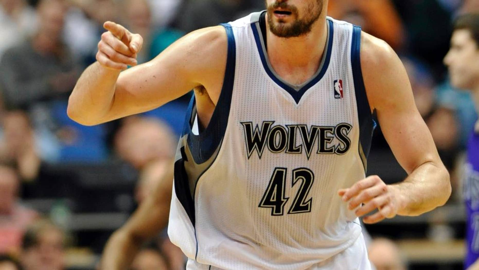 FILE - In this Jan. 16, 2012, file photo, Minnesota Timberwolves' Kevin Love reacts during the second half of an NBA basketball game against the Sacramento Kings in Minneapolis. The Timberwolves, Cleveland Cavaliers and Philadelphia 76ers completed a blockbuster trade sending Love to team up with LeBron James in Cleveland for 2014 No. 1 draft pick Andrew Wiggins on Saturday, Aug. 23, 2014, a person familiar with the trade said. The Timberwolves are getting Wiggins and former top pick Anthony Bennett from Cleveland and veteran forward Thaddeus Young from Philadelphia. The 76ers get a 2015 first-round draft choice from Cleveland, and guard Alexey Shved and forward Luc Mbah a Moute from Minnesota. (AP Photo/ Jim Mone, File)