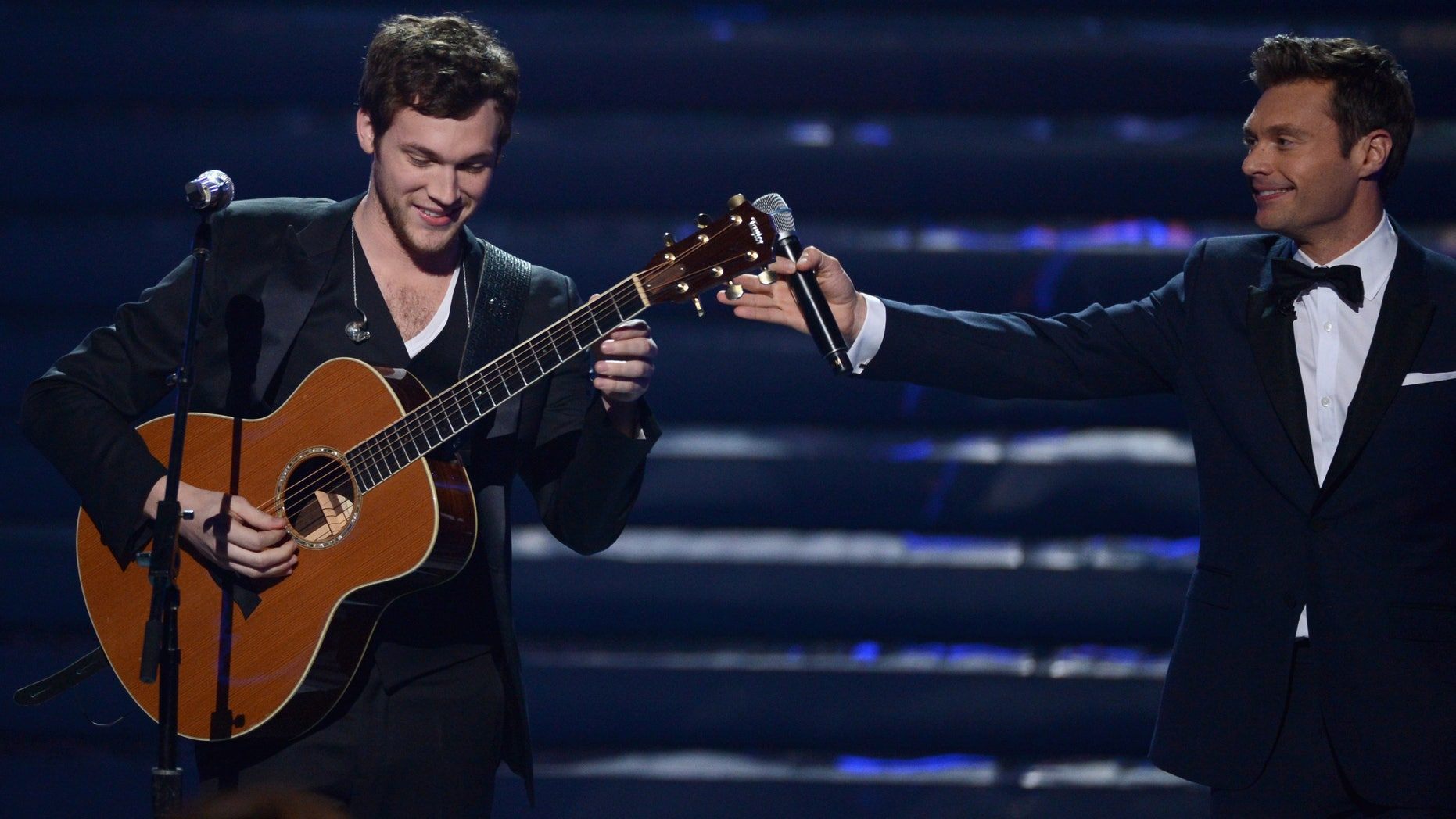"""May 23, 2012: Winner Phillip Phillips and host Ryan Seacrest speak onstage during Fox's """"American Idol 2012"""" results show at Nokia Theatre L.A. Live in Los Angeles, California."""