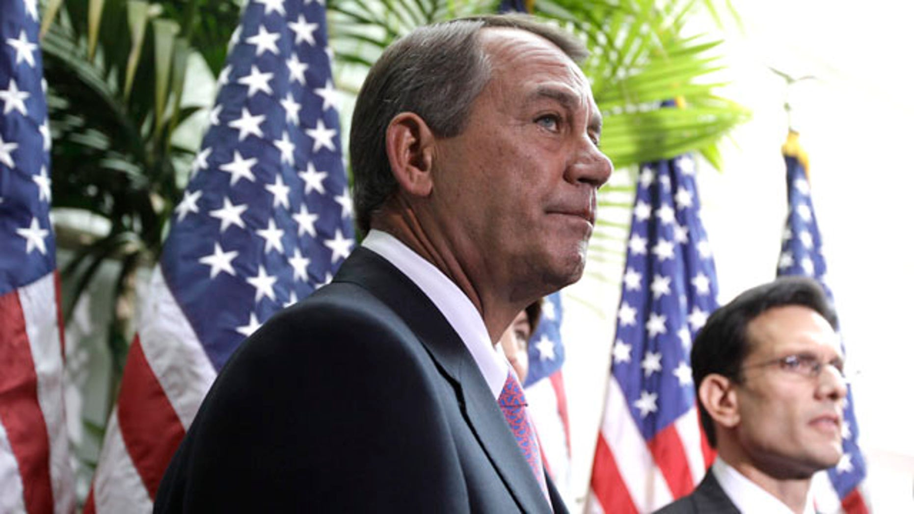 Jan. 25: House Speaker John Boehner of Ohio accompanied by House Majority Leader Eric Cantor of Virginia, listen to a question from reporters on Capitol Hill in Washington, D.C. House Republicans have offered $4 billion in cuts in an effort to prevent a government shutdown.