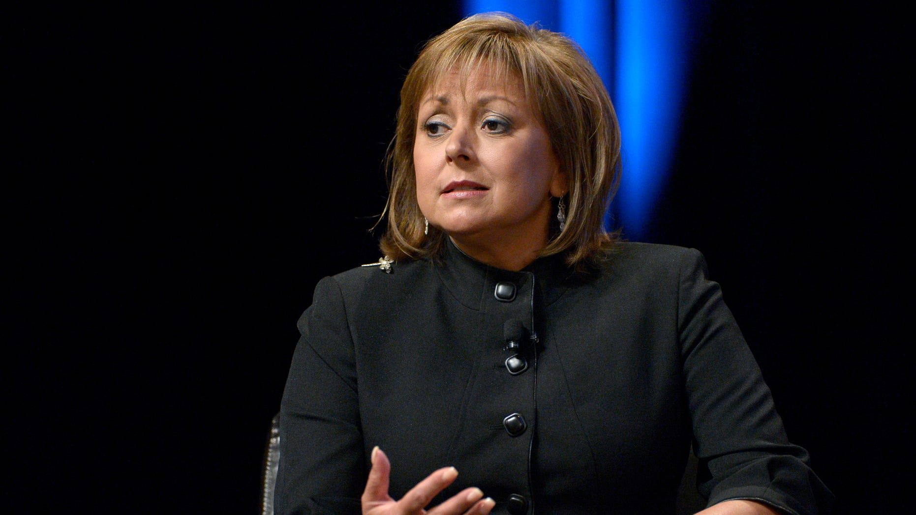 FILE - In this Aug. 22, 2013, file photo, Republican New Mexico Gov. Susana Martinez answers a question during a panel discussion at the Wal-Mart U.S. Manufacturing Summit in Orlando, Fla. Martinez and Democratic challenger Gary King will square off Monday, Oct. 6, 2014, in a televised Spanish-language debate aimed at the state's Hispanic voters. (AP Photo/Phelan M. Ebenhack, File)