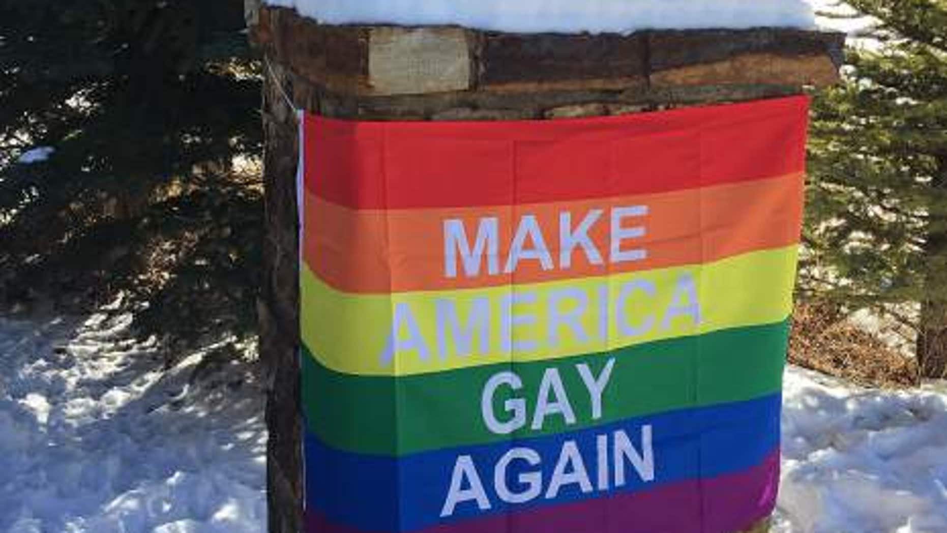 "A rainbow banner reading ""Make America Gay Again"" appeared in front of the house where Pence is staying."
