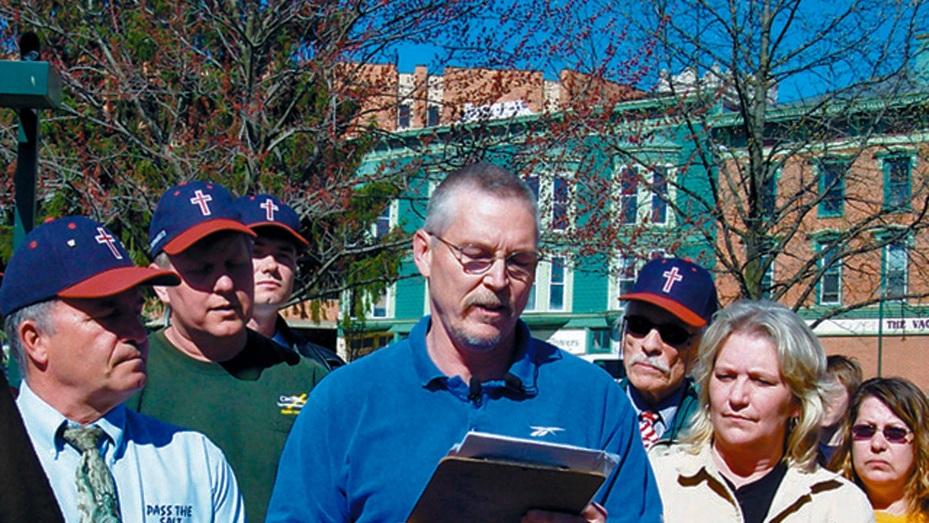 FILE - In this April 16, 2008 file photo, John Freshwater, center, addresses a crowd on Mount Vernon's public square in Mount Vernon, Ohio. The Ohio Supreme Court is ready to hear arguments in the case of Freshwater, a fired public school science teacher who kept a bible on his desk and was accused of preaching religious beliefs in class. (AP Photo/Mount Vernon News, Pam Schehl, File)