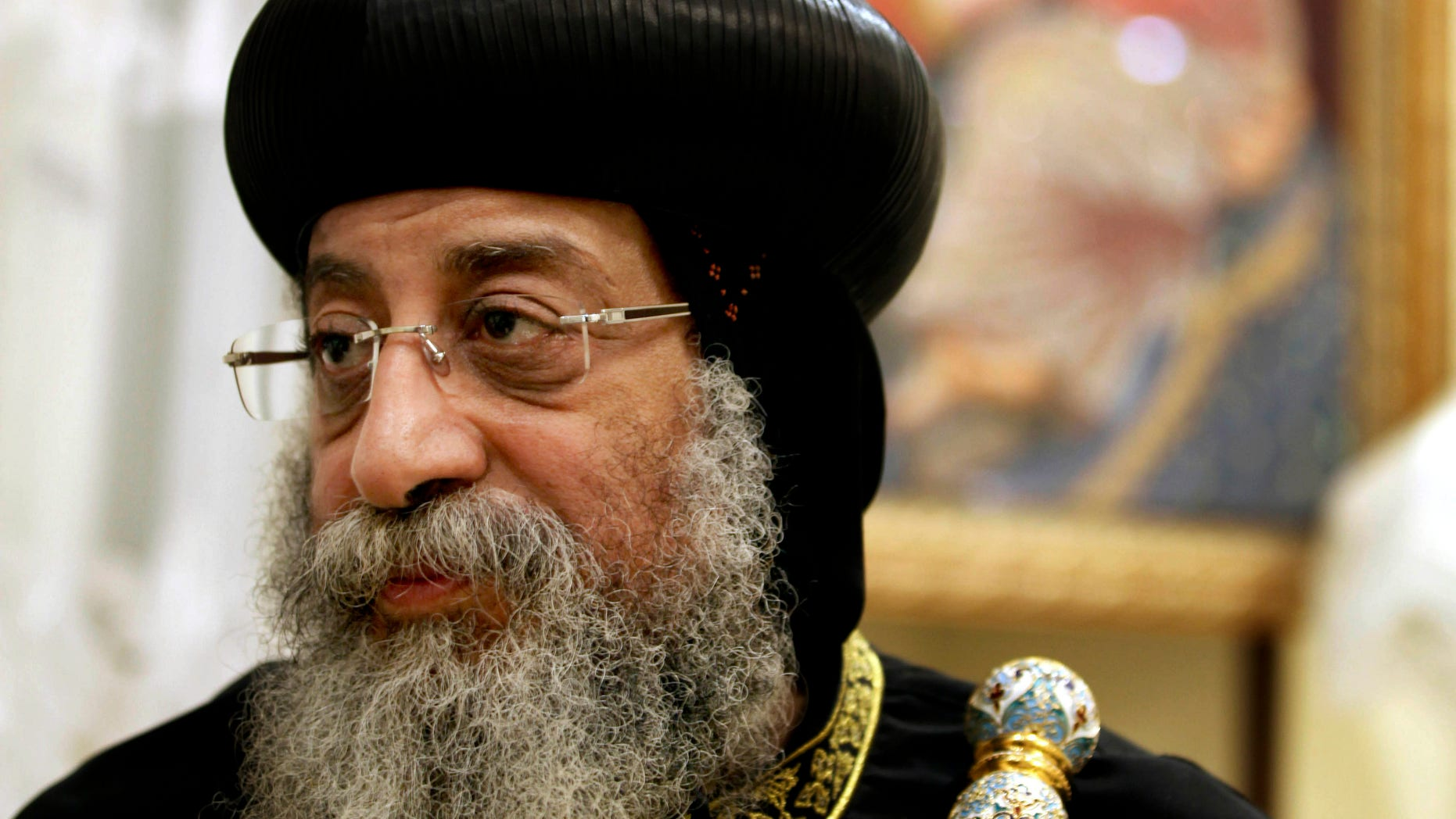 Feb. 5, 2013: In this file photo, Egypt's Coptic Christian Pope, Tawadros II speaks to The Associated Press in the province of Assiut, Egypt. Christians angered by the killing of four Christians in weekend sectarian violence clashed Sunday after a funeral with a mob throwing rocks and firebombs, killing at least one person and turning Cairo's main Coptic cathedral into a battleground. Tawadros who was not in the cathedral, his headquarters, during the funeral and the violence that followed, called for calm as the specter of sectarian violence threatened to spread to the rest of the country.
