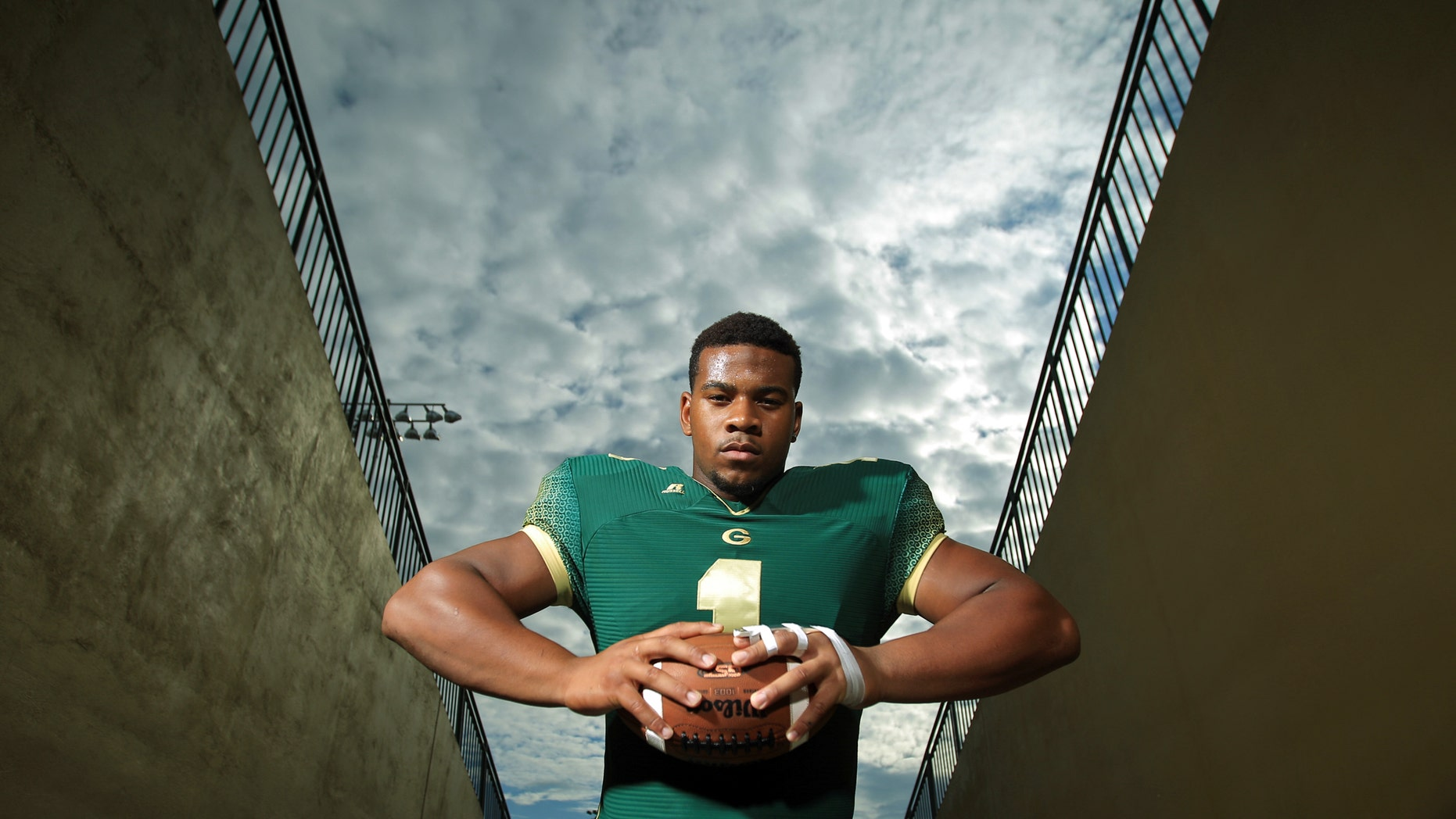 In this photo taken Aug. 6, 2012, Grayson defensive lineman Robert Nkemdiche poses for a portrait in Loganville, Ga.  Nkemdiche is the consensus No. 1 high school recruit in the nation and is being compared to such former greats as Reggie White and current stars as Jadeveon Clowney. (AP Photo/Atlanta-Journal, Constitution, Jason Getz) MARIETTA DAILY OUT; GWINNETT DAILY POST OUT; LOCAL TV OUT; WXIA-TV OUT; WGCL-TV OUT