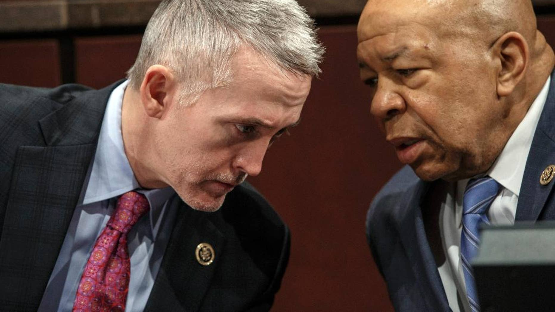 "FILE - In this Jan. 27, 2015, file photo, House Benghazi Committee Chairman Rep. Trey Gowdy, R-S.C., left, confers with the committee's ranking member Rep. Elijah Cummings, D-Md., during the committee's hearing on Capitol Hill in Washington. The committee has missed a self-imposed deadline to issue a report ""before summer,"" the latest setback for a probe that has gone on for more than two years and drawn scorn from Democrats who say the primary goal of the Republican-led investigation is to undermine Hillary Clinton's presidential bid.(AP Photo/J. Scott Applewhite, File)"