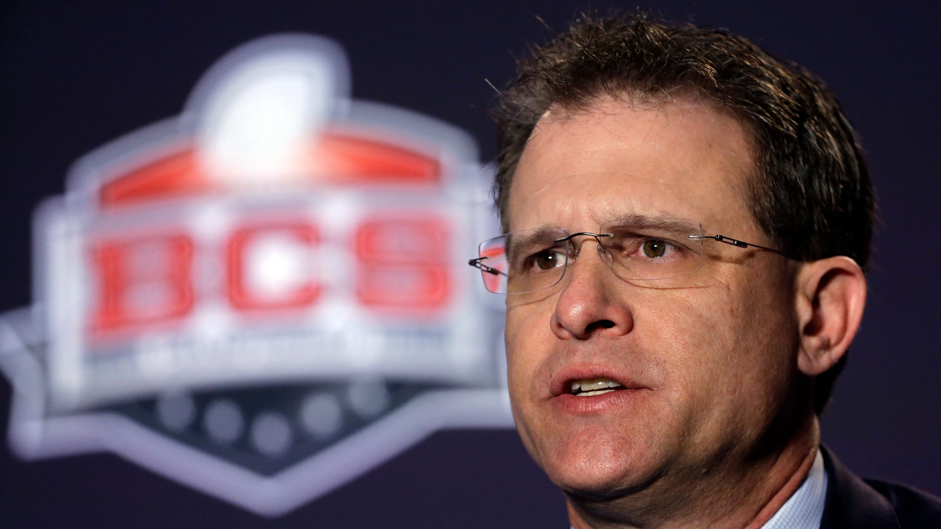 Auburn head coach Gus Malzahn answers a question during a news conference for the NCAA BCS National Championship college football game Sunday, Jan. 5, 2014, in Newport Beach, Calif. Florida State plays Auburn on Monday, Jan. 6, 2014. (AP Photo/David J. Phillip)
