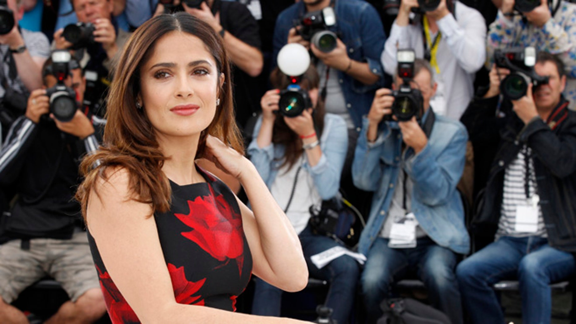 Actress Salma Hayek poses for photographers during a photo call for the film Tale of Tales, at the 68th international film festival, Cannes, southern France, Thursday, May 14, 2015. (AP Photo/Lionel Cironneau)