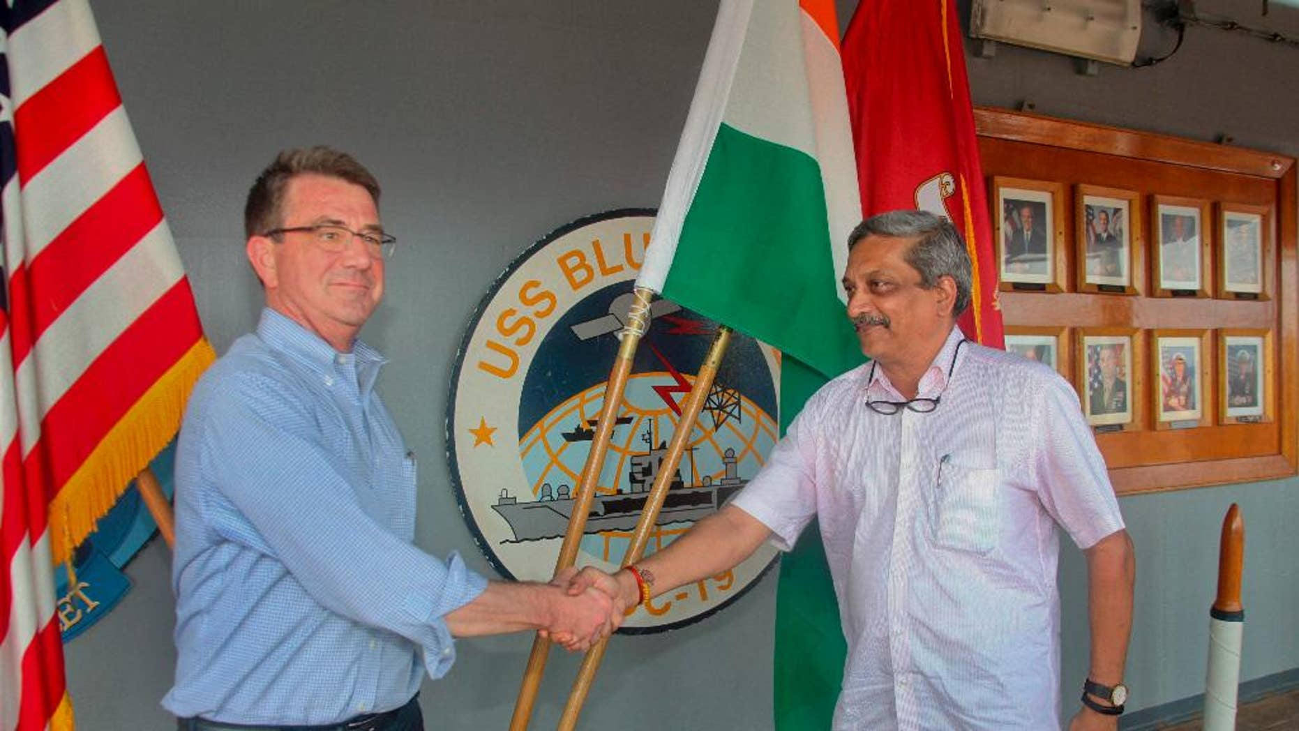 Indian Defence Minister Manohar Parrikar, right, greets US Defense Secretary Ashton Carter during his visit to the Indian Naval Base in Karwar, Karnataka state, India,  Monday, April 11, 2016.(Press Trust of India via AP)INDIA OUT