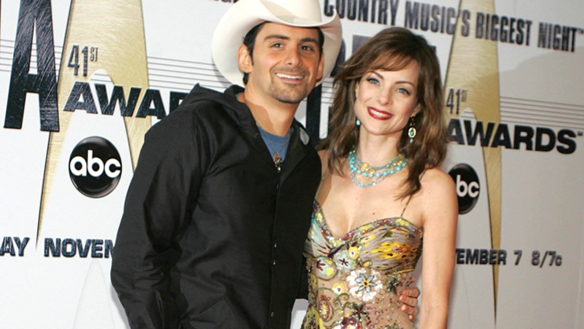 Singer Brad Paisley and his wife, actress Kimberly Williams-Paisley, pose as they arrive at the 41st annual Country Music Awards in Nashville, Tennessee.