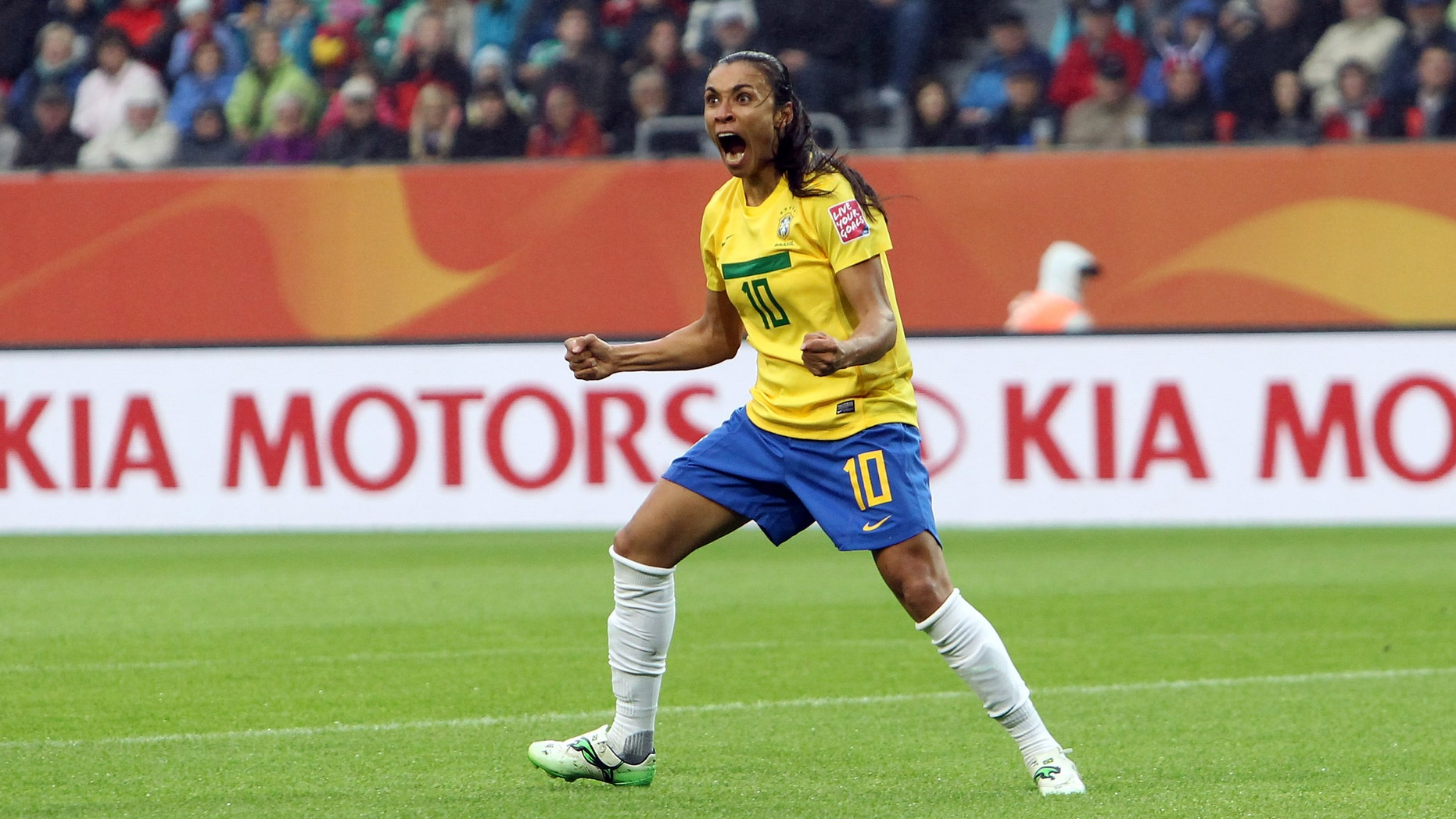 WOLFSBURG, GERMANY - JULY 03: Marta of Brazil celebrates after she scores her team's openin goal during the FIFA Women's World Cup 2011 Group D match between Brazil and Norway at Wolfsburg Arena on July 3, 2011 in Wolfsburg, Germany. (Photo by Martin Rose/Bongarts/Getty Images)