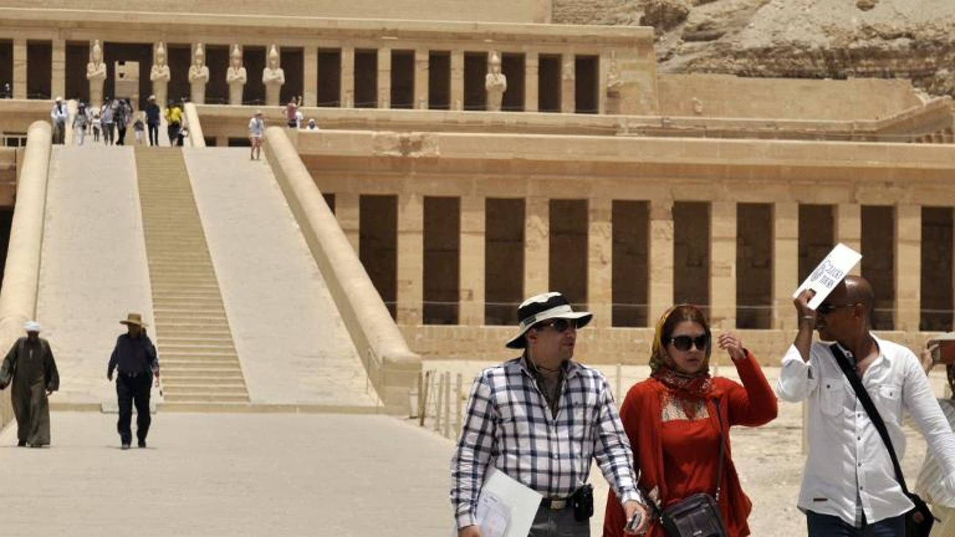 Iranian tourists visit the Temple of Hatshepsut in Egypt on June 3, 2013