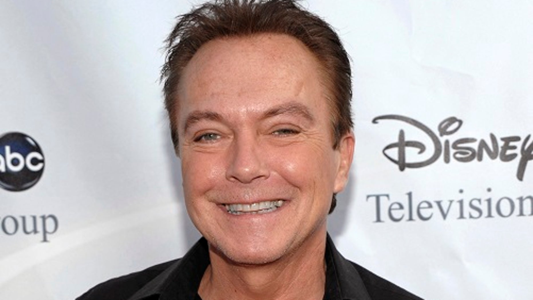 "FILE - In this Aug. 8, 2009, file photo, actor-singer David Cassidy arrives at the ABC Disney Summer press tour party in Pasadena, Calif. Former teen idol Cassidy of ""The Partridge Family"" fame has died at age 67, publicist said Tuesday, Nov. 21, 2017. (AP Photo/Dan Steinberg, File)"