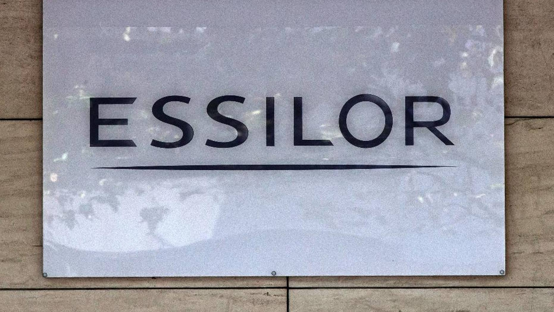 This Thursday, Sept. 22, 2016 photo shows the logo of the Essilor a French ophthalmic optics company, in Charenton le Pont, east of Paris. Essilor International SA announced Monday Jan.16, 2017 it had reached a share exchange deal with Luxottica's main shareholder Delfin to create a combined company making both frames and lenses. (AP Photo/Michel Euler)