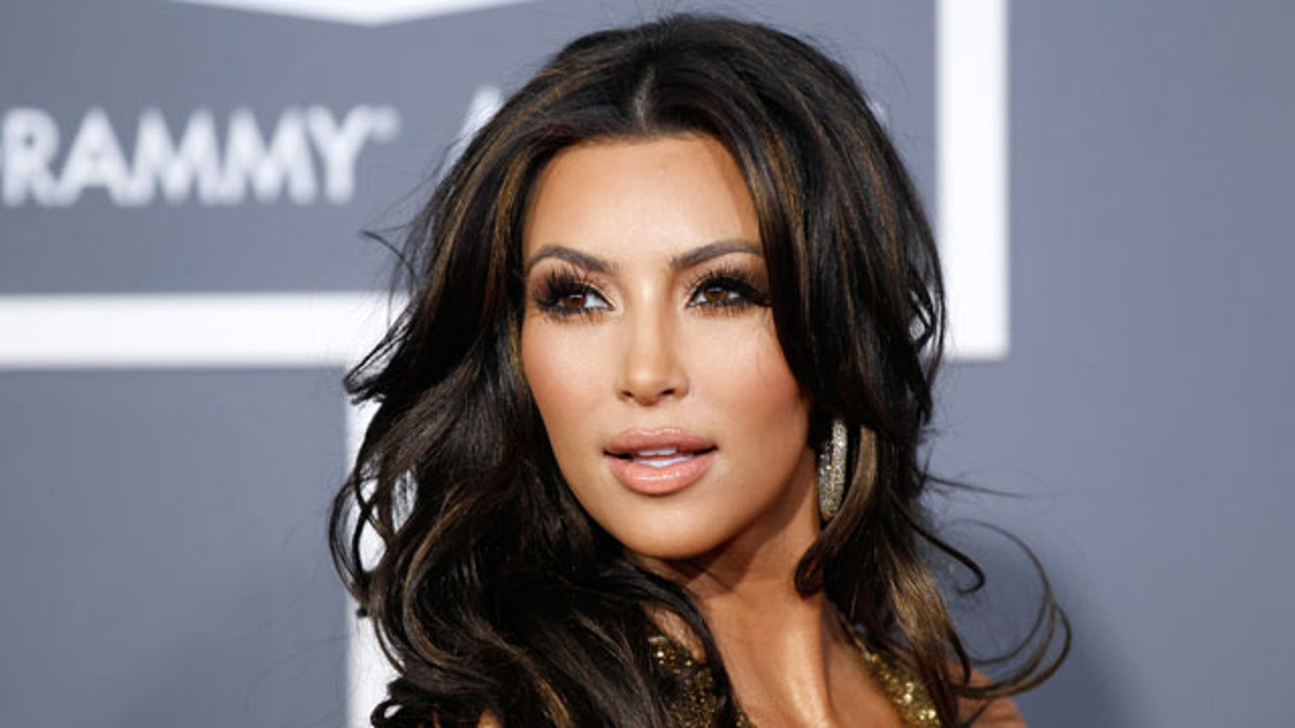 TV personality Kim Kardashian arrives at the 53rd annual Grammy Awards in Los Angeles