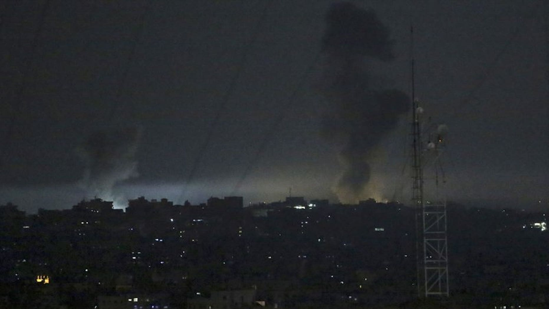 Smoke rises following an Israeli strikes on Gaza City, early Wednesday, May 30, 2018. Palestinian militants in the Gaza Strip fired at least 50 rockets and mortars into southern Israel on Tuesday, the largest barrage since the 2014 war between Israel and Hamas.