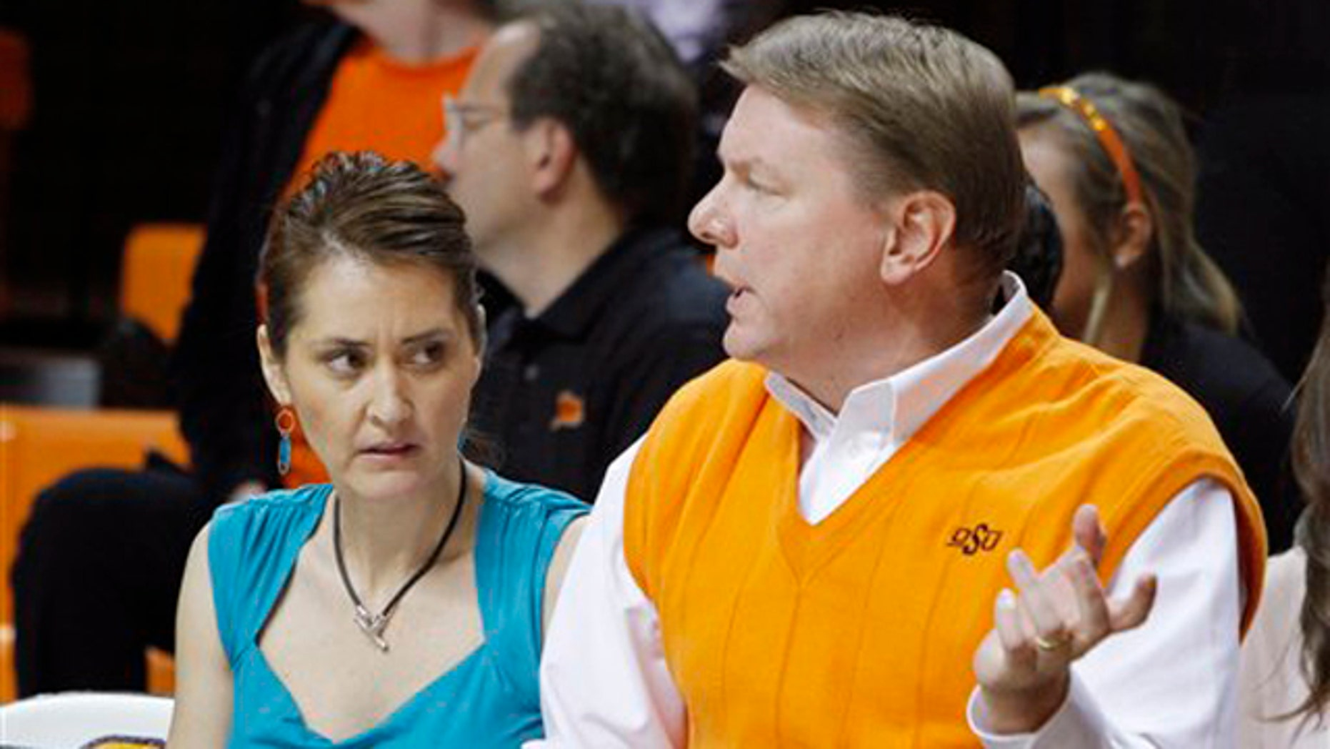 November 9, 2011: Oklahoma State women's basketball coach Kurt Budke and assistant coach Miranda Serna talk during an an exhibition women's NCAA college basketball game against Fort Hays State, in Stillwater, Okla.