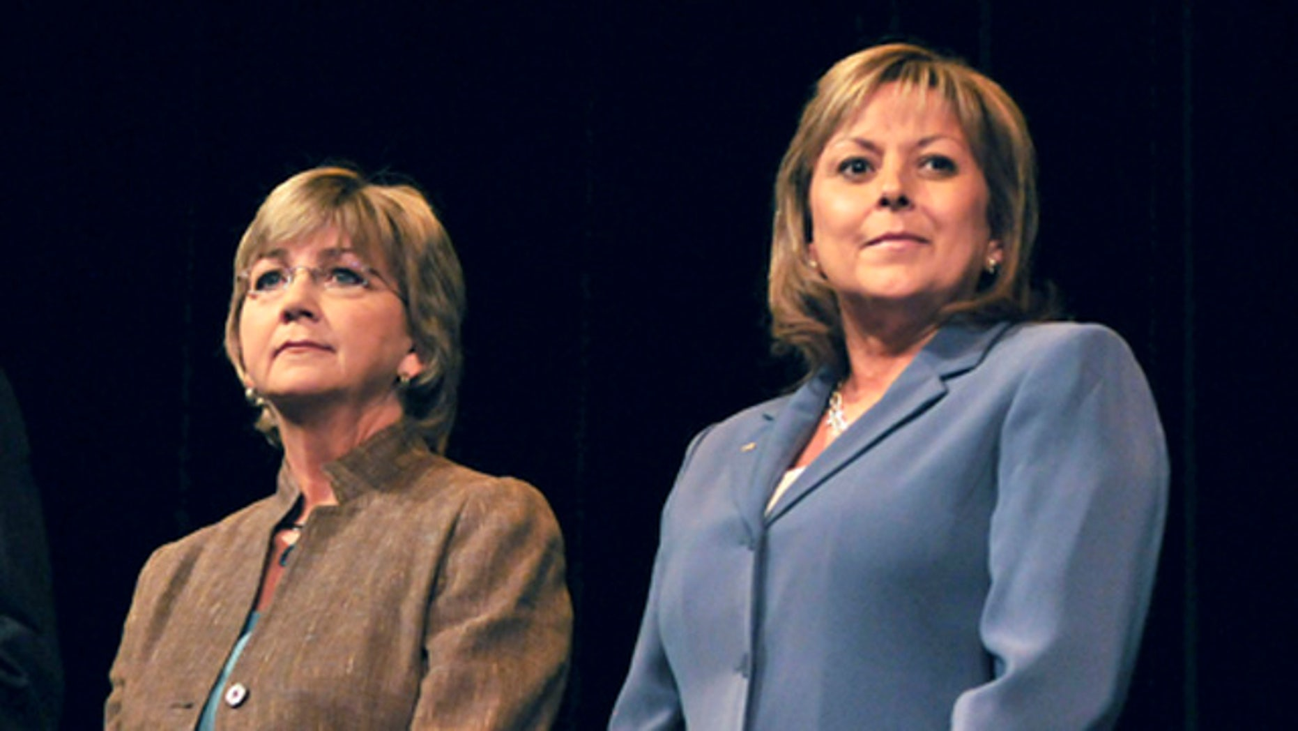FILE - In this Aug. 19, 2010 file photo, gubernatorial candidates Diane Denish (D), left, and Susana Martinez (R) prepare to square off during the New Mexico Gubernatorial Education Debate in Albuquerque, N.M. In a historic race where New Mexico will elect its first female governor, the outcome could hinge on voter discontent with a man not even on the ballot: Gov. Bill Richardson. The governor's popularity has plunged amid corruption investigations as he nears the end of his second term, and his presence looms large in the race between Martinez and Democratic Lt. Gov. Diane Denish. (AP Photo/Albuquerque Journal, Roberto E. Rosales, File)