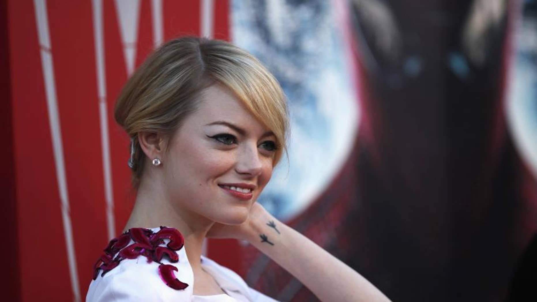 Actress Emma Stone says her 'organs shifted' after wearing a corset for a month for a movie role.