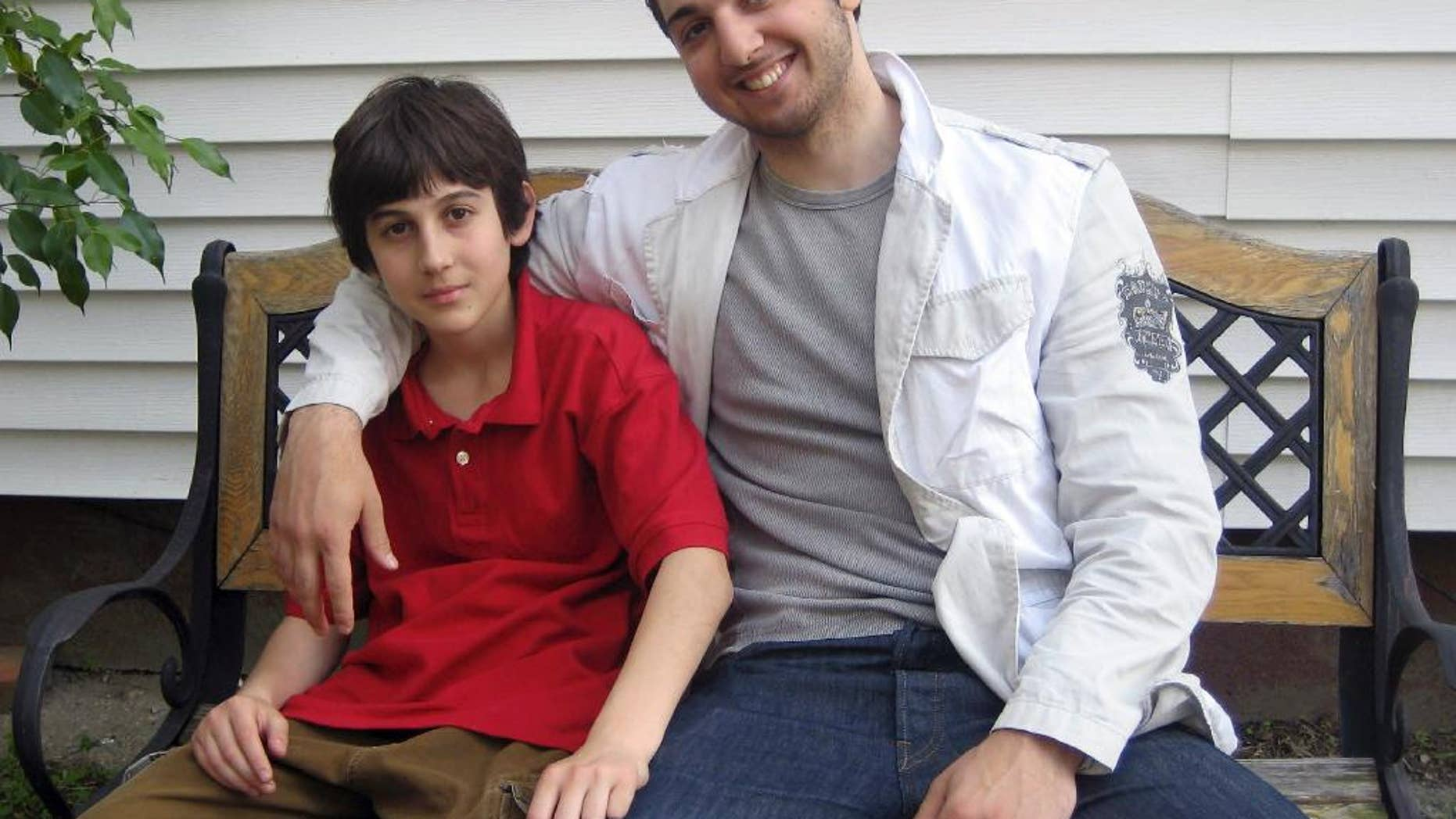 This undated photo released Wednesday, April 29, 2015, by the Federal Public Defender Office and presented as evidence during the penalty phase in the trial of Dzhokhar Tsarnaev in Boston, brothers Dzhokhar, left, and Tamerlan Tsarnaev sit together at an unknown location. Dzhokhar Tsarnaev was convicted of the Boston Marathon bombings that killed three and injured more than 260 spectators in April 2013. Tamerlan Tsarnaev died in a firefight with police days after the bombings. (AP Photo/Federal Public Defender Office)