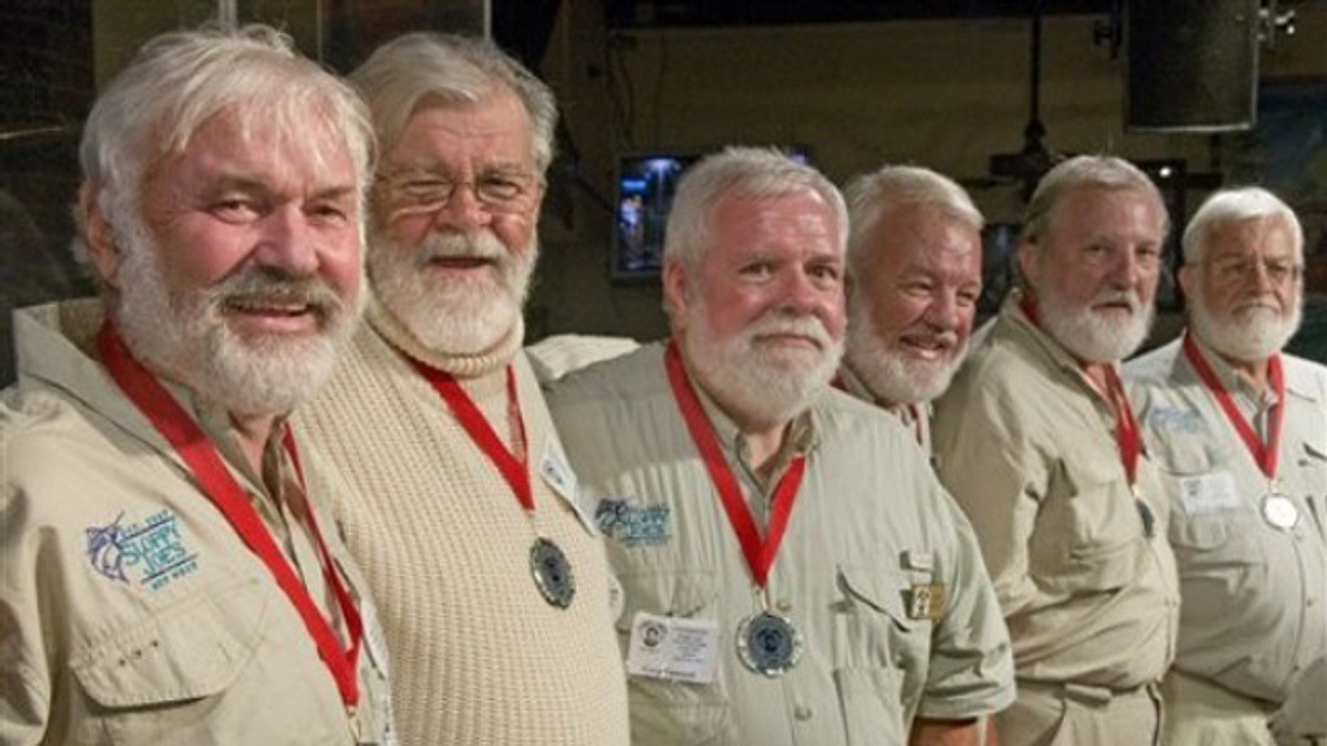 """In this photo, released by the Florida Keys News Bureau, some of the semi-finalists of the 2011 """"Papa"""" Hemingway Look-Alike Contest including, from left, Arnie Inge-Mathisen, Bear Hoochuck, Greg Fawcett, Charlie Boice, Ed Lindoo and Frank Long show their to looks to the audience during the first of two preliminary rounds Thursday, July 21, 2011, at Sloppy Joe's Bar in Key West, Fla. More than 120 men resembling Ernest Hemingway are entered into the contest that is a facet of Key West's annual Hemingway Days festival. The finals are set for Saturday, July 23."""
