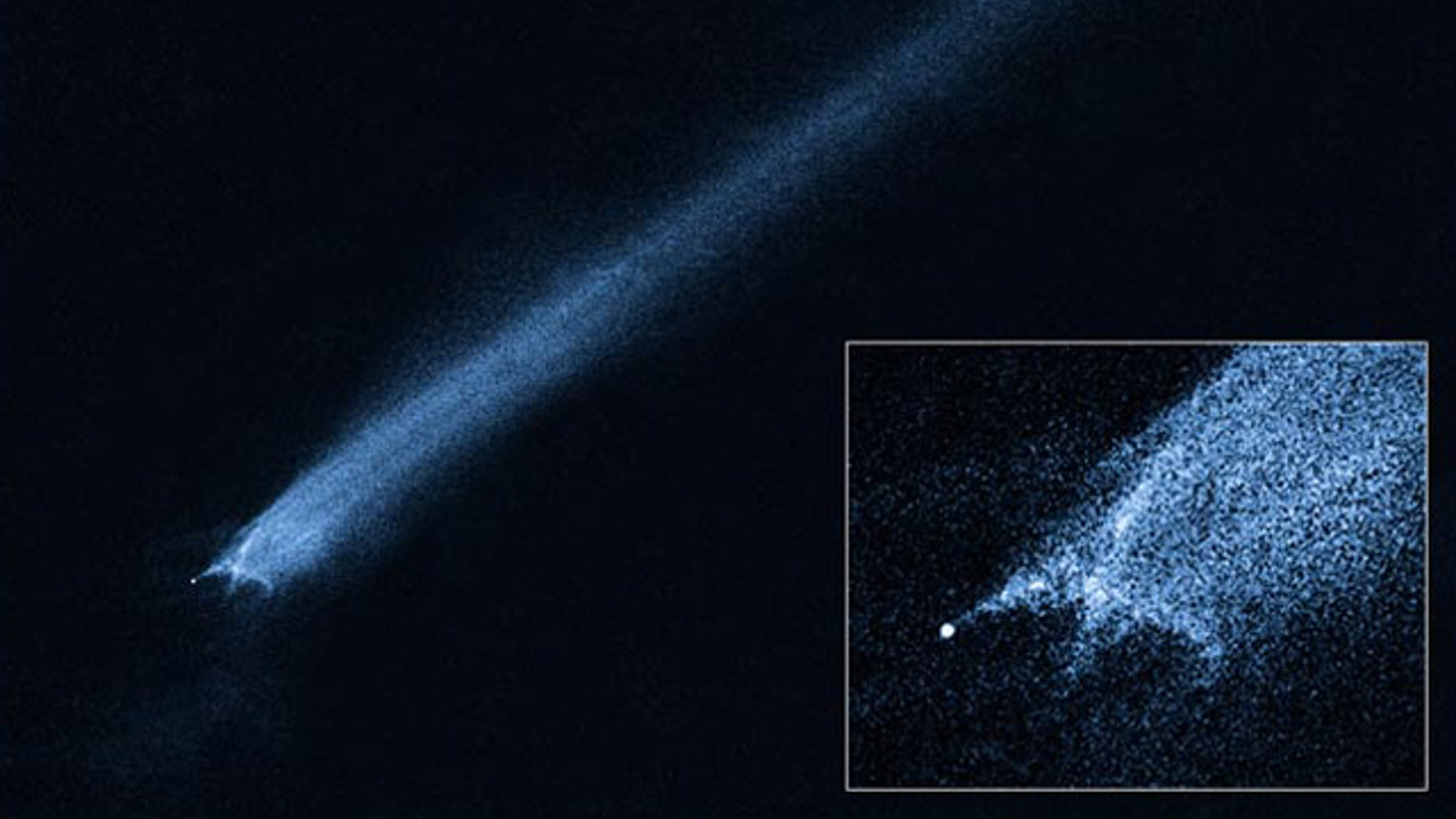 A Hubble Space Telescope picture of a comet-like object called P/2010 A2 shows a bizarre X-pattern of filamentary structures near the point-like nucleus of the object and trailing streamers of dust. Scientists think the object is the remnant of an asteroid collision.
