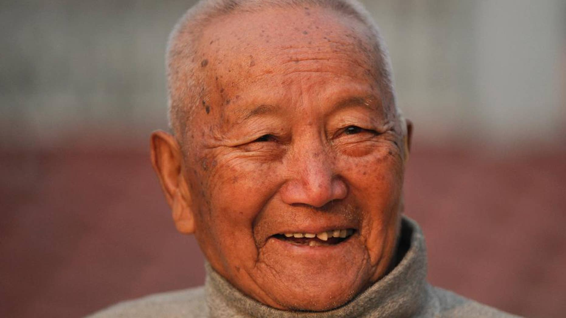 Nepalese mountain climber Min Bahadur Sherchan, 85, smiles after his morning yoga workout at home in Kathmandu, Nepal, last month.