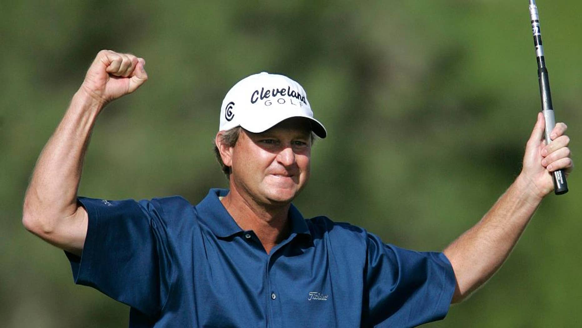 FILE - In this Sunday, Oct. 16, 2005 file photo, Wes Short Jr. reacts after sinking a birdie putt on the 18th hole to face Jim Furyk in the playoff during the final day of  Michelin Championship  in Las Vegas. Short first tried to qualify for the U.S. Open when he was a high school senior in Texas. He finally made it 34 years later at age 52. The U.S. Open is June 16-19, 2016 at Oakmont  (AP Photo/Jae C. Hong, File)