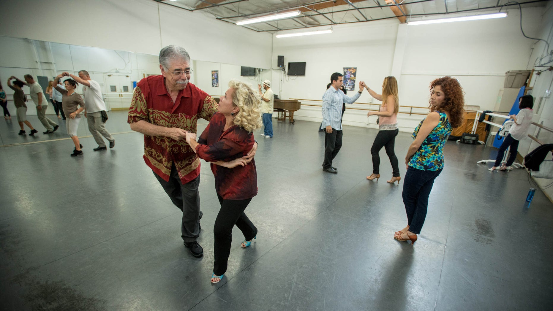 Charles Trevino, a patient at Cedars-Sinai Medical Center, and his wife Carmen during salsa dancing lessons at the Pasadena Dance Theatre, Thursday, Nov. 14,  2013. (Eric Reed/Cedars-Sinai Medical Center)
