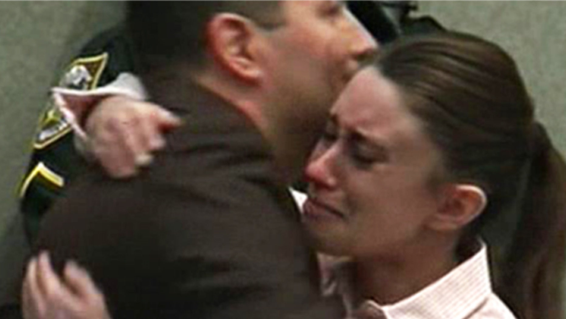 July 5: Casey Anthony hugs her attorney, Jose Baez, after hearing a jury clear her of killing her 2-year-old daughter, Caylee.