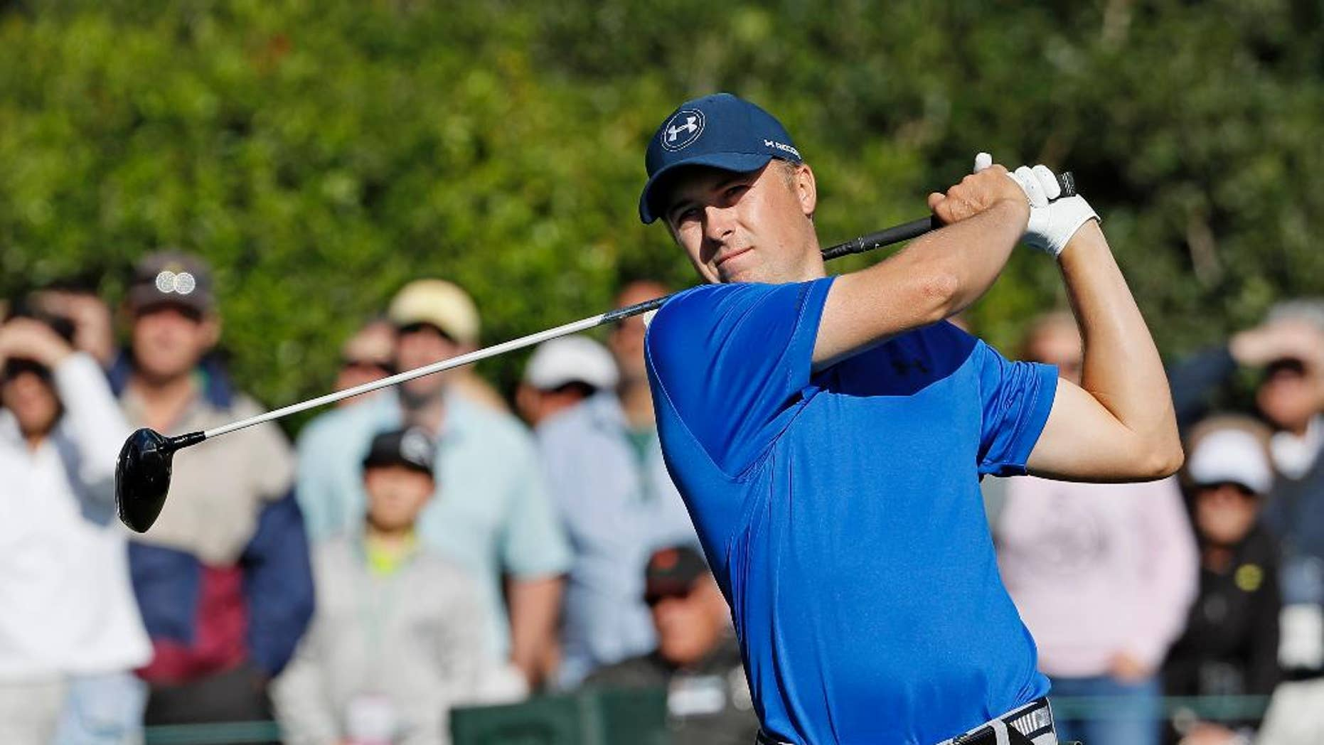 FILE - In this Friday, April 8, 2016 file photo, Jordan Spieth tees off on the 15th hole during the second round of the Masters golf tournament in Augusta, Ga. Jordan Spieth understands his meltdown at the end of the Masters will follow him. And three weeks later Spieth's not quite ready to say he's over letting a five-shot in the final round morph into that awkward ceremony in the Butler Cabin that ended with him slipping the green jacket on Danny Willett following an ugly and very public collapse.(AP Photo/David J. Phillip, File)