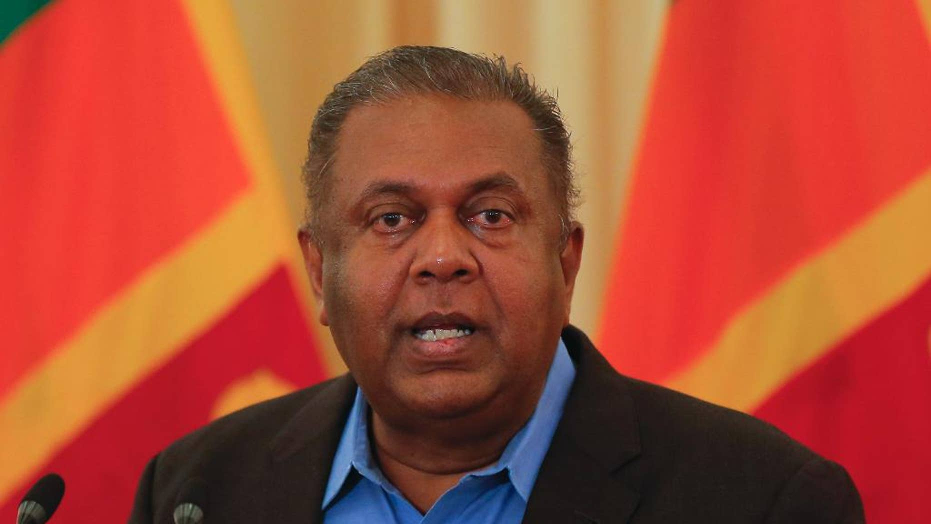 Sri Lankan Foreign Minister Mangala Samaraweera gestures as he addresses the media after returning from a U.N. Human Rights Council meeting in Geneva in Colombo, Sri Lanka, Wednesday, July 6, 2016.Sri Lanka's government plans to set up a special court by next year to hear allegations of abuses during the country's decades-long civil war, the foreign minister said Wednesday. (AP Photo/Eranga Jayawardena)