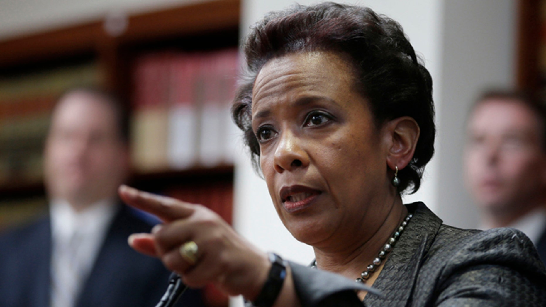 April 28, 2014: Loretta Lynch, U.S. Attorney for the Eastern District of New York, speaks during a news conference in New York. President Obama chose Loretta Lynch as attorney general on Nov. 7, 2014, which would make her the first black woman in the position. (AP/Seth Wenig, File)