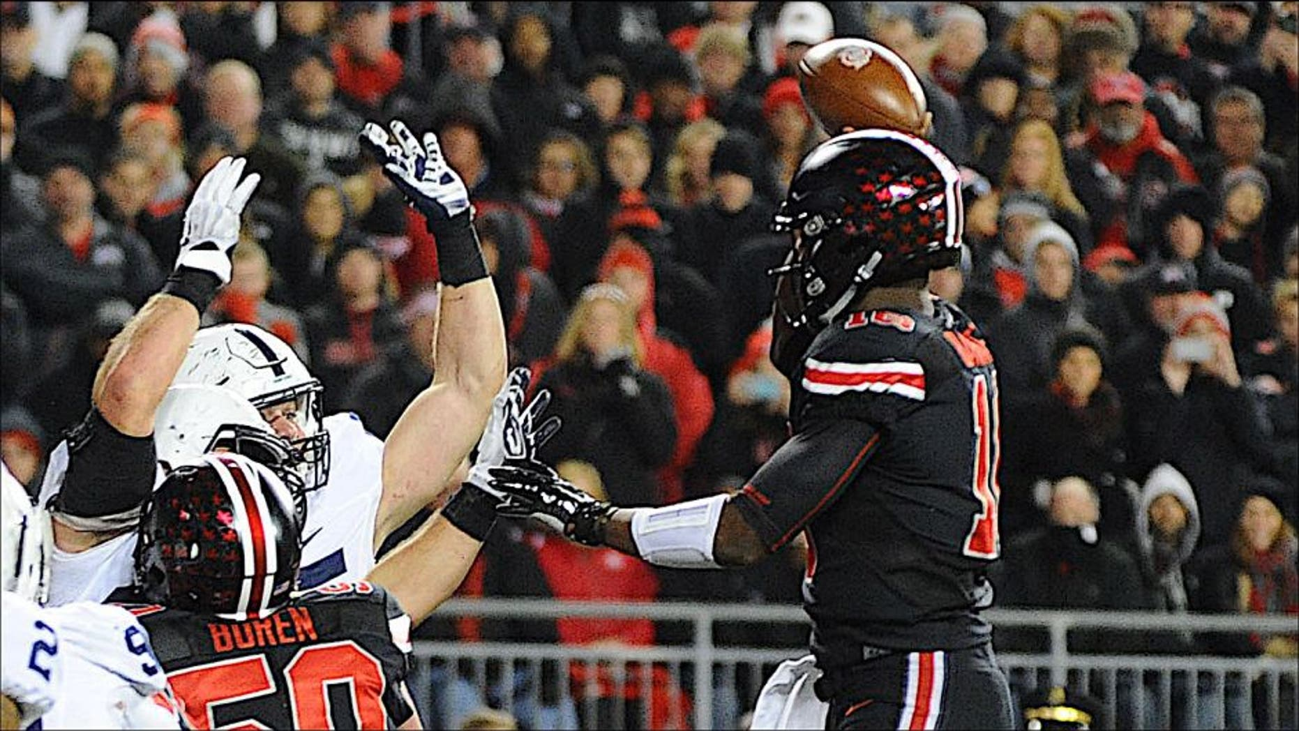 Oct 17, 2015; Columbus, OH, USA; Ohio State Buckeyes quarterback J.T. Barrett (16) throws a touchdown pass in the fourth quarter against the Penn State Nittany Lions at Ohio Stadium. Mandatory Credit: James Lang-USA TODAY Sports