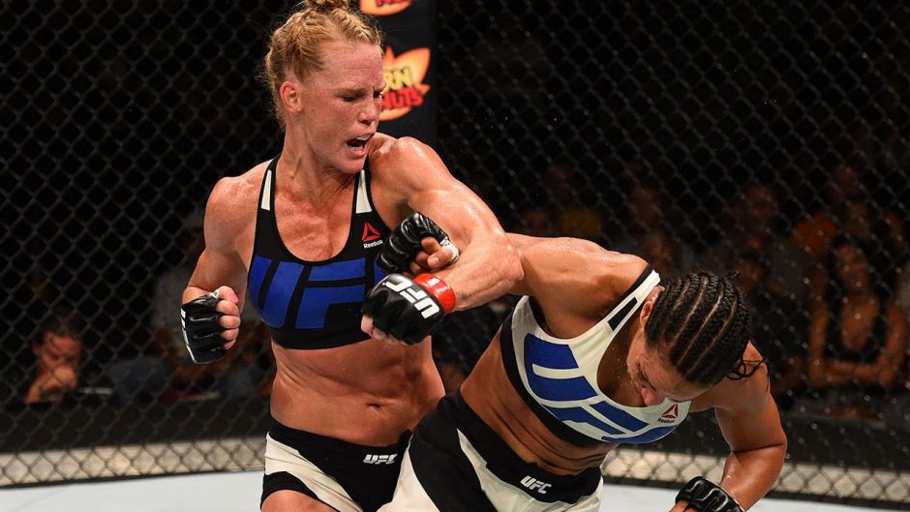 SAN DIEGO, CA - JULY 15: (L-R) Holly Holm punches Marion Reneau in their women's bantamweight bout during the UFC event at the Valley View Casino Center on July 15, 2015 in San Diego, California. (Photo by Jeff Bottari/Zuffa LLC/Zuffa LLC via Getty Images)