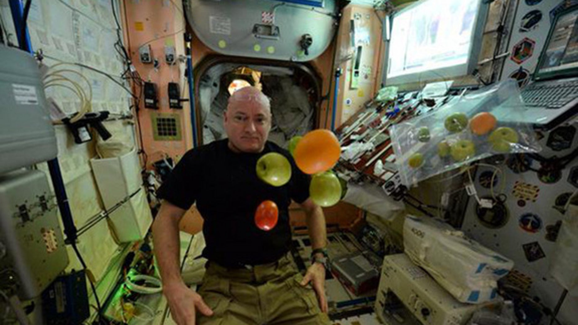 Astronaut Scott Kelly enjoys fresh fruit on Day 100 of his one-year trip aboard the International Space Station. This week Kelly talked with reporters about what life is like in orbit.