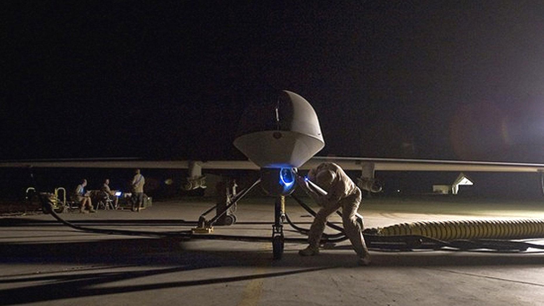 A pre-flight inspection of an MQ-1B Predator unmanned drone aircraft.
