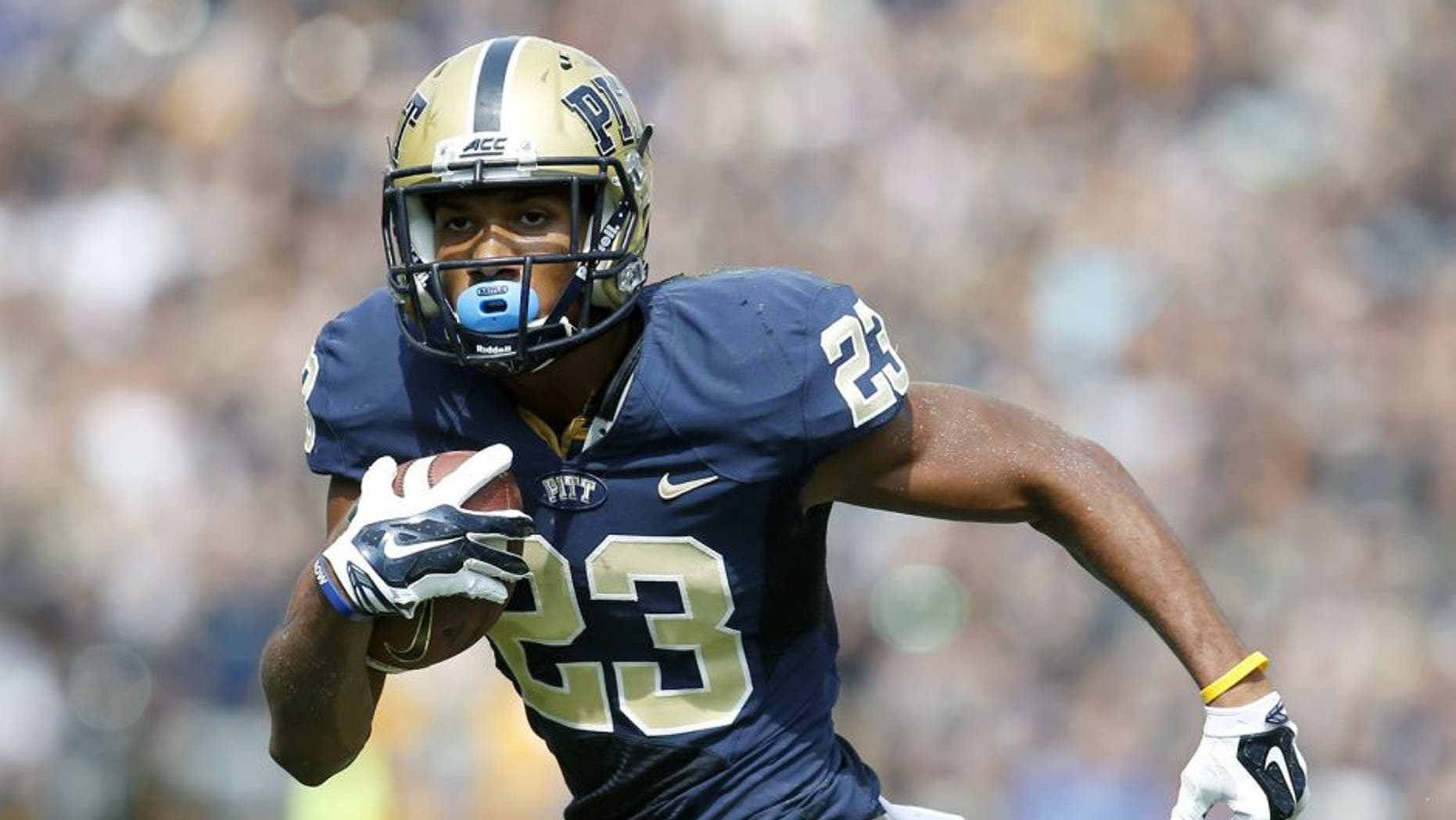 Sep 20, 2014; Pittsburgh, PA, USA; Pittsburgh Panthers wide receiver Tyler Boyd (23) runs after a pass reception against the Iowa Hawkeyes during the second quarter at Heinz Field. Mandatory Credit: Charles LeClaire-USA TODAY Sports