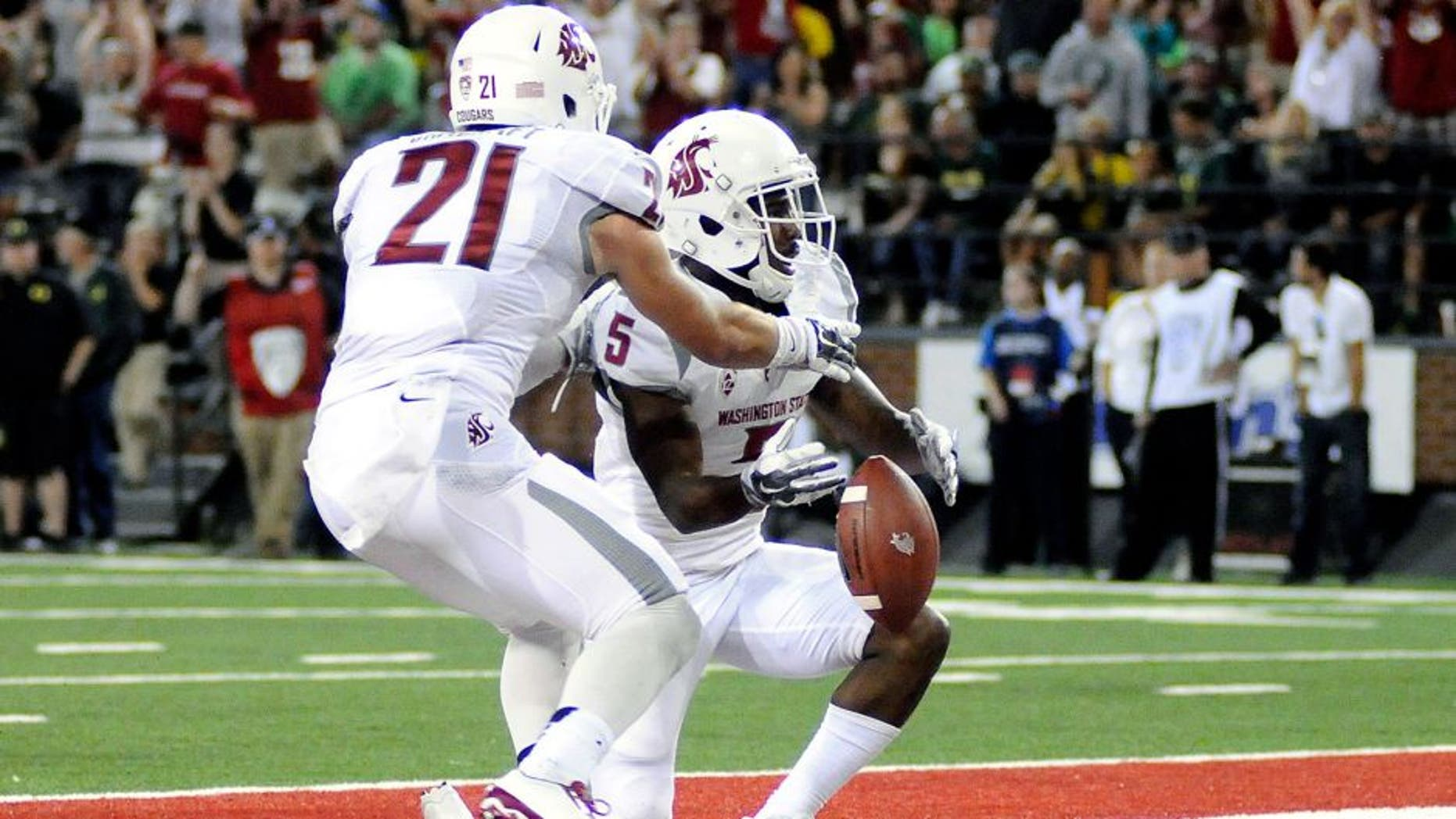Sep 20, 2014; Pullman, WA, USA; Washington State Cougars wide receiver Rickey Galvin (5) and wide receiver River Cracraft (21) celebrate a touchdown against the Oregon Ducks during the first half at Martin Stadium. Mandatory Credit: James Snook-USA TODAY Sports