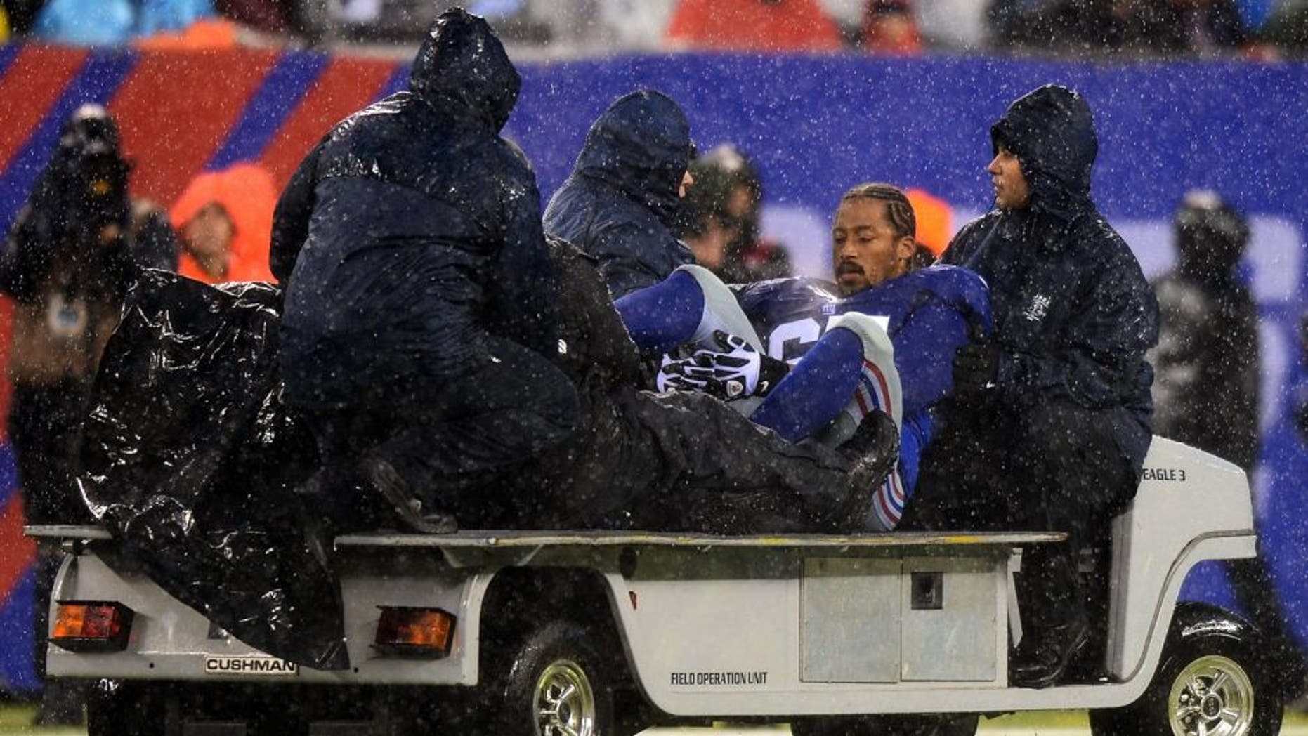 EAST RUTHERFORD, NJ - DECEMBER 29: Tackle Will Beatty #65 of the New York Giants leaves the game against the Washington Redskins with an injury during the second half at MetLife Stadium on December 29, 2013 in East Rutherford, New Jersey. (Photo by Ron Antonelli/Getty Images)