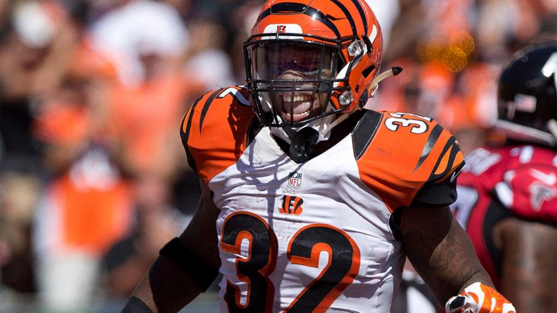 Sep 14, 2014; Cincinnati, OH, USA; Cincinnati Bengals running back Jeremy Hill (32) celebrates a touchdown in the second half against the Atlanta Falcons at Paul Brown Stadium. The Bengals won 24-10. Mandatory Credit: Aaron Doster-USA TODAY Sports