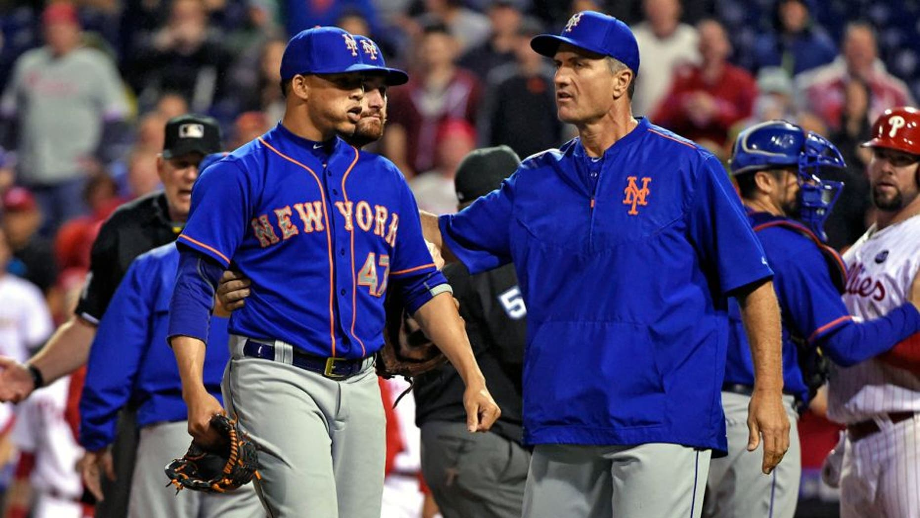 Sep 30, 2015; Philadelphia, PA, USA; New York Mets relief pitcher Hansel Robles (47) walks off the field after he threw inside to Philadelphia Phillies catcher Cameron Rupp (29) during the sixth inning against the New York Mets at Citizens Bank Park. Mandatory Credit: Eric Hartline-USA TODAY Sports