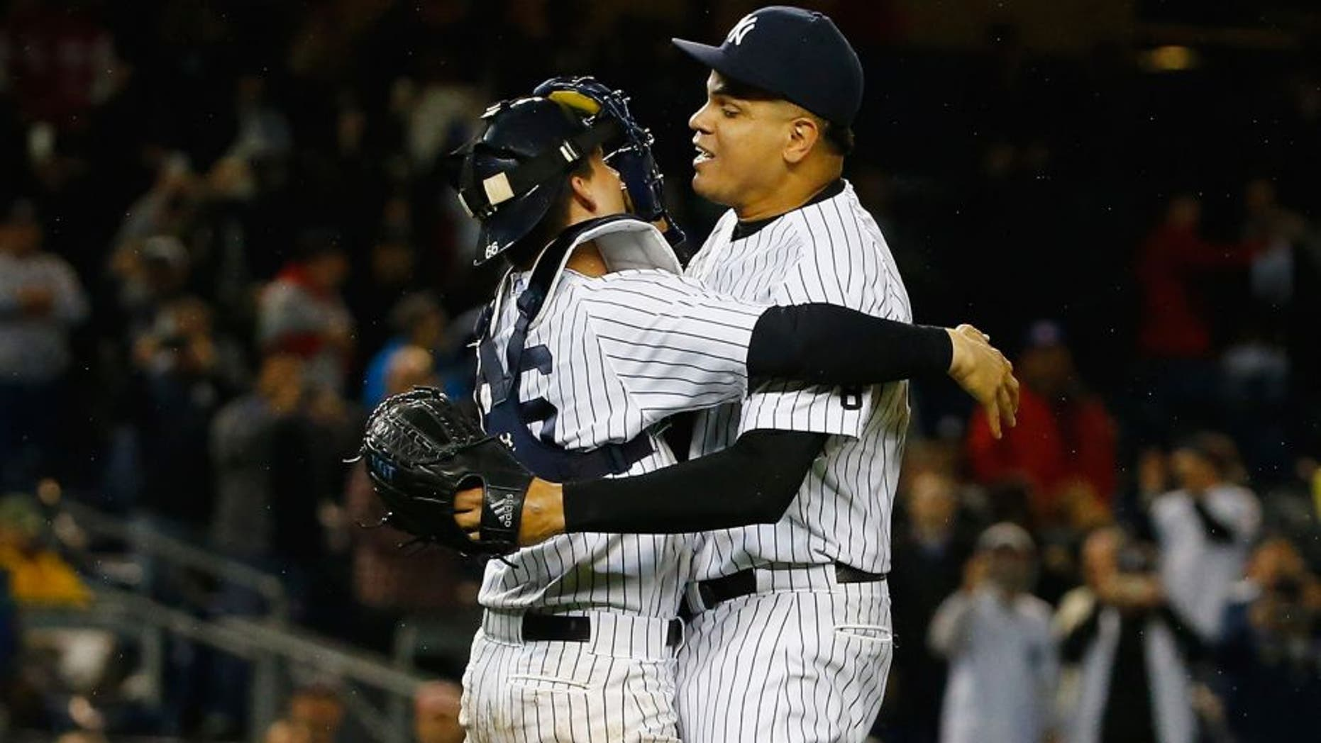 NEW YORK, NY - OCTOBER 01: John Ryan Murphy #66 of the New York Yankees and Dellin Betances #68 celebrate the New York Yankees 10000th win and their wildcard clinching berth to the playoffs against the Boston Red Sox after their game at Yankee Stadium on October 1, 2015 in New York City. (Photo by Al Bello/Getty Images)