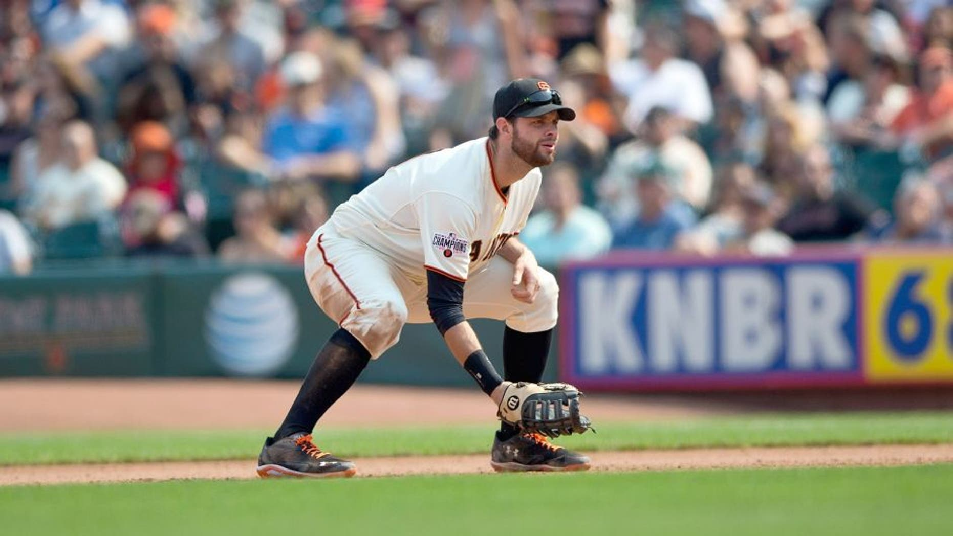 SAN FRANCISCO, CA - SEPTEMBER 13: Brandon Belt #9 of the San Francisco Giants stands on the field against the San Diego Padres during the seventh inning at AT&T Park on September 13, 2015 in San Francisco, California. The San Francisco Giants defeated the San Diego Padres 10-3. (Photo by Jason O. Watson/Getty Images)