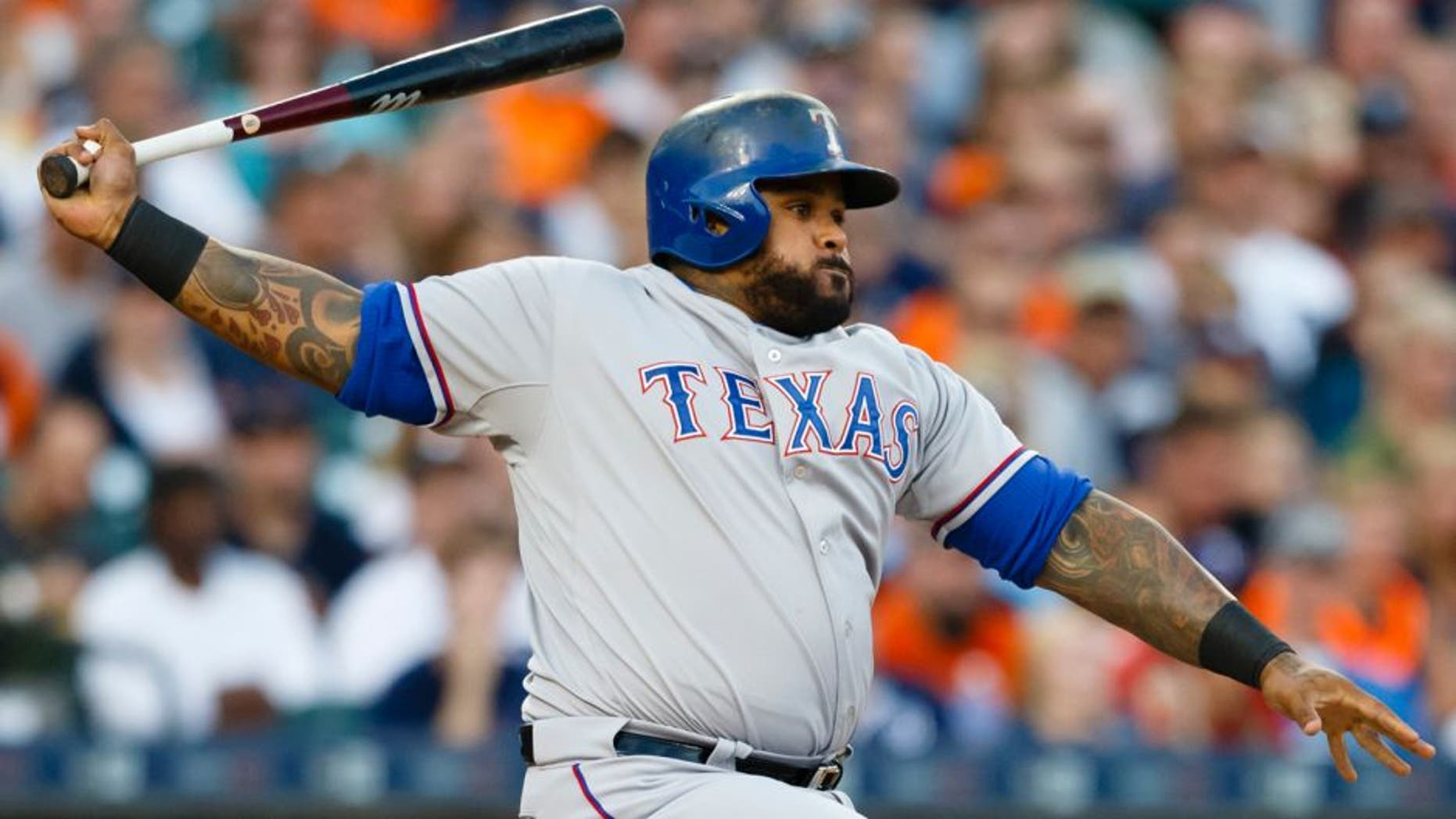 Aug 22, 2015; Detroit, MI, USA; Texas Rangers designated hitter Prince Fielder (84) hits an RBI single in the third inning against the Detroit Tigers at Comerica Park. Mandatory Credit: Rick Osentoski-USA TODAY Sports