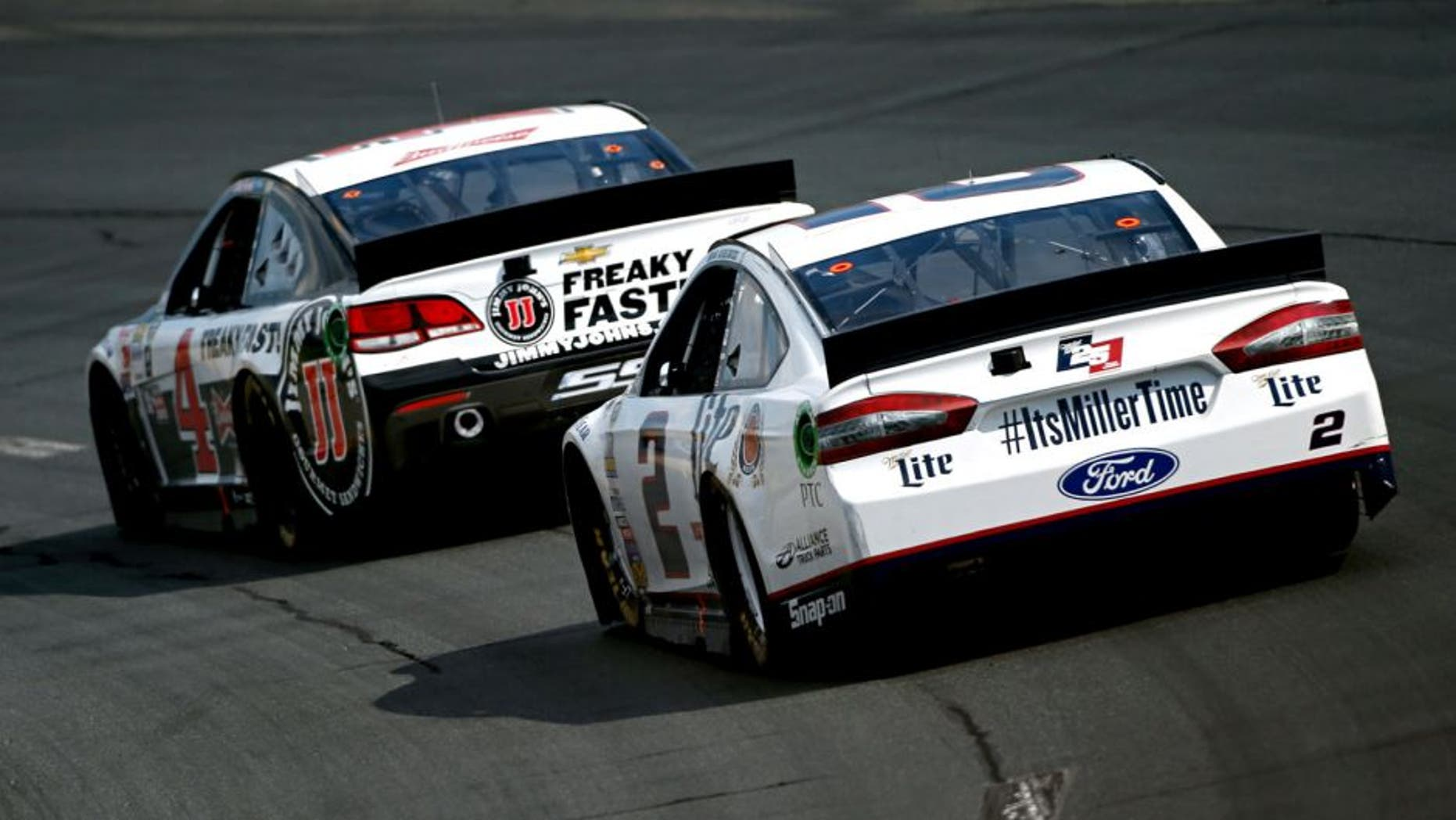 LOUDON, NH - JULY 19: Kevin Harvick, driver of the #4 Jimmy John's/Budweiser Chevrolet, leads Brad Keselowski, driver of the #2 Miller Lite Ford, during the NASCAR Sprint Cup Series 5-Hour ENERGY 301 at New Hampshire Motor Speedway on July 19, 2015 in Loudon, New Hampshire. (Photo by Todd Warshaw/NASCAR via Getty Images)