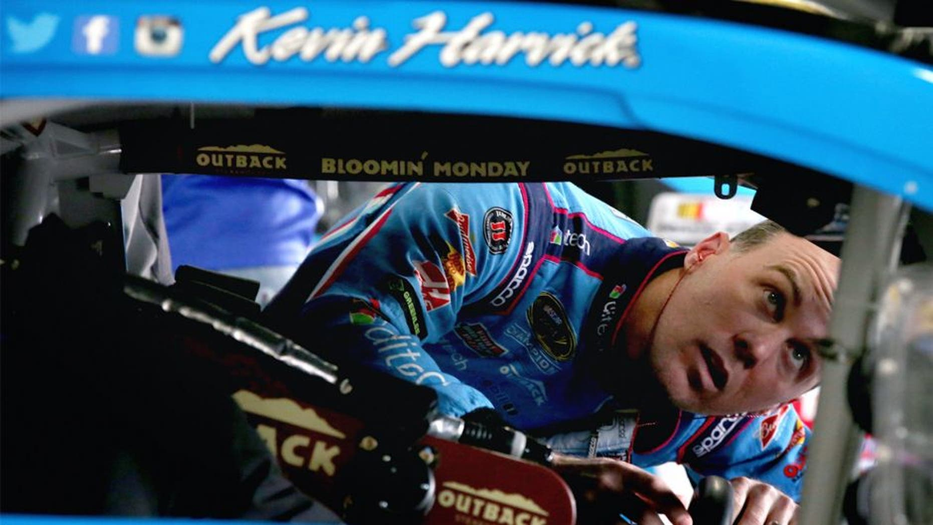 LOUDON, NH - SEPTEMBER 25: Kevin Harvick, driver of the #4 Ditech Chevrolet, stands in the garage area during practice for the NASCAR Sprint Cup Series Sylvania 300 at New Hampshire Motor Speedway on September 25, 2015 in Loudon, New Hampshire. (Photo by Sean Gardner/Getty Images)