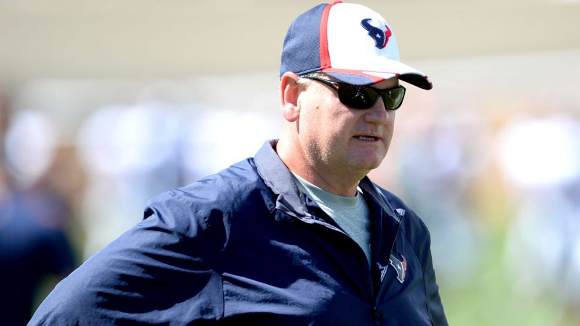 Aug 20, 2014; Englewood, CO, USA; Houston Texans offensive line coach Paul Dunn before the start of a scrimmage against the Denver Broncos at the Broncos training facility. Mandatory Credit: Ron Chenoy-USA TODAY Sports