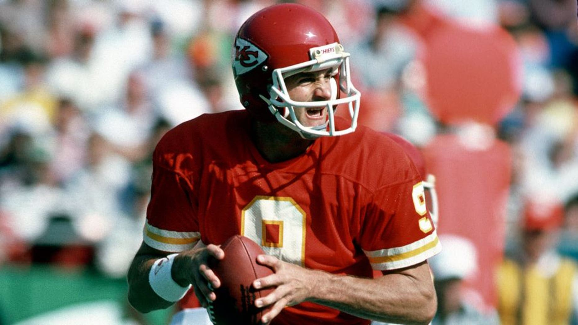 KANSAS CITY, MO - OCTOBER 27: Bill Kenney #9 of the Kansas City Chiefs drops back to pass against the Denver Broncos during an NFL football game October 27, 1985 at Arrowhead Stadium in Kansas City, Missouri. Kenney played for the Chiefs from 1980-88. (Photo by Focus on Sport/Getty Images)